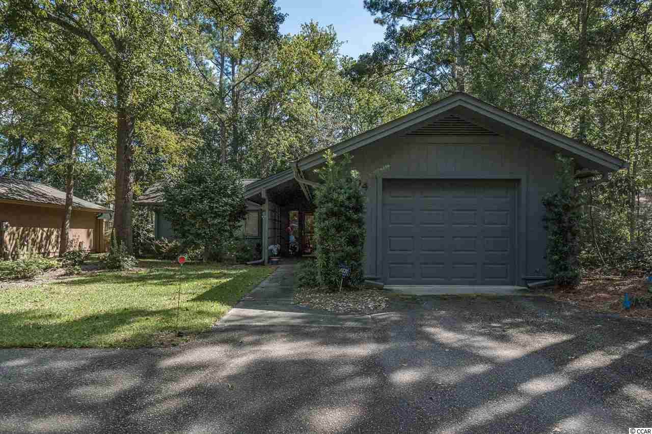 Awesome Turn-Key Patio home in the desirable Briarwood neighborhood located in the Briarcliffe Acres section of Myrtle Beach.  As a buyer, you will appreciate the care and upkeep of this home by current owners. All hard surface floors through-out ~ Laminate in living areas, bedrooms and ceramic tile in both baths. Both baths feature walk-in showers w/ glass doors and the master shower has built-in seat. The large master suite has an enormous amount of closet space with 3 closets plus a linen closet. Two sets of sliding glass doors- one from the master and one from the living area, lead you to two new wooden decks that overlook  your peaceful shaded fenced back yard. The second bedroom has sliders that open up to the covered walkway. The open living/ dining area has raised ceilings.  The wonderful up-dated kitchen has granite ~ Stainless Steel GE/ Whirlpool appliances ~ Travertine Tile Backsplash ~Track lighting. The set of floor to ceiling cabinets is like having a large pantry. Off the kitchen is a Laundry Room with closet.  The Garage has its own water heater, utility sink and is heated and cooled.  Great curb appeal with mature hardwood trees and complete irrigation. HOA  maintains the front yard! The community pool is waterfront on the ICW. Fantastic central location ~ One mile south of Barefoot Landing and so close to the beach, you can feel the breeze!  Put this home on your short list of those to see. Square footage is approximate and not guaranteed. Buyers responsible for verification.