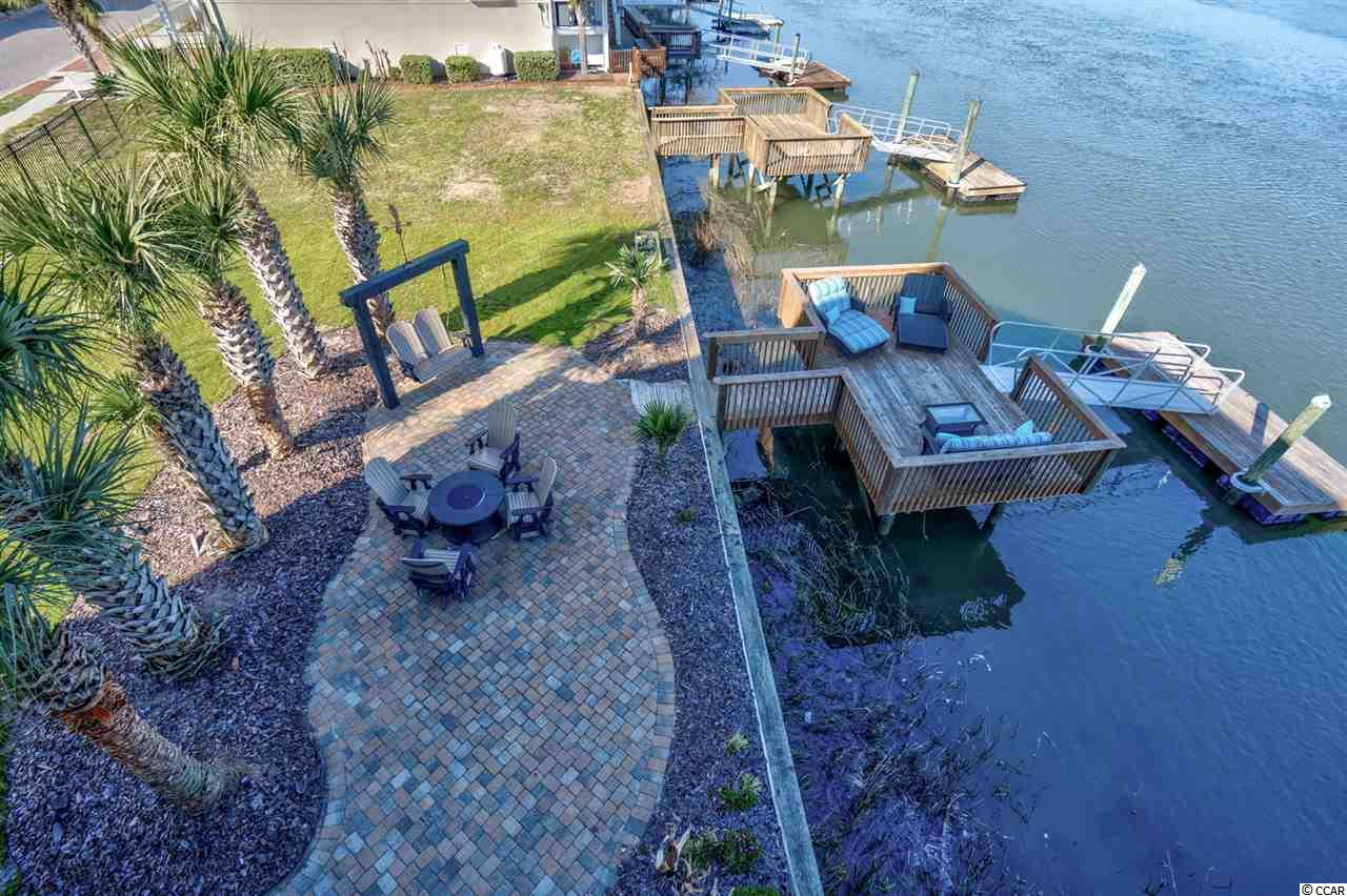 This is the only lot available in the lovely waterfront community Heritage Shores located in Cherry Grove! This Residential lot sits on the main channel in Cherry Grove, and has been completely dredged. No history of flooding. The space is currently used as a lounging area with a fire pit and private dock, but has the potential for you to build your dream home!!! With no HOA, water access, close proximity to beach and the nature preserve, Heritage Shores proves to be the perfect community.  Check out this unique lot today!!!