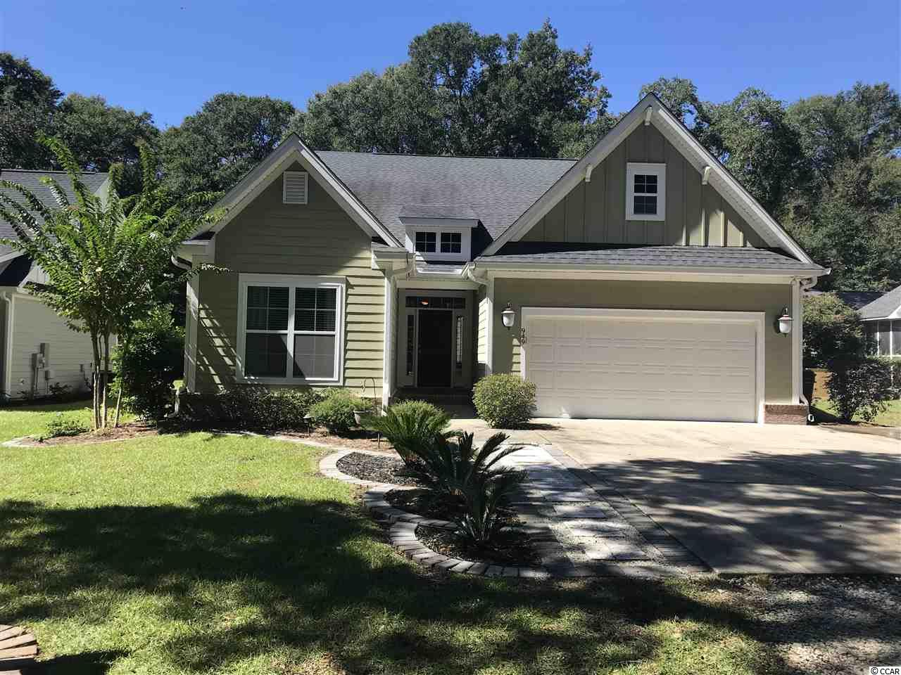 This 4 BR, 3 1/2 BA home in Pawleys Island is stunning! The enormous master bedroom has a luxurious bath with custom tiled shower, garden tub, double sink, and a huge walk-in closet. The kitchen and breakfast area are designer perfect with granite countertops and stainless steel appliances. The upstairs bedroom has its own bath and bonus room, The living room has a high ceiling and is open to the kitchen for easy entertaining. Classic touches throughout this home include hard wood flooring, tray ceilings, crown molding, and a back screen porch. This home is in a great location -close to the boat landing on the Waccamaw River and only a short distance to the beach. Home is not in a flood zone. Hagley Estates is a community known for easy living ..CHECK IT OUT!