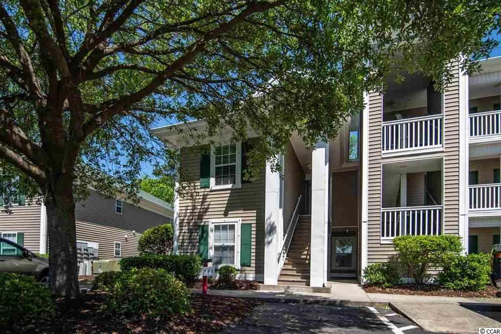 A beautiful condo located right in the heart of Pawleys Island, the True Blue Community.  With gorgeous sights and sounds, surrounded by the most pristine golf courses in South Carolina. This three bedroom, three bathroom condo features vaulted ceilings, split bedroom layout, and a quiet, cozy back porch facing woods.  Walking distance to both the pool, and True Blue Driving range. Not even five minutes from the beach and river. Weekly rentals are permitted, making this a fantastic rental / investment property. And the central location and quiet atmosphere makes for a great primary residence as well. Come see for yourself the True Blue lifestyle!