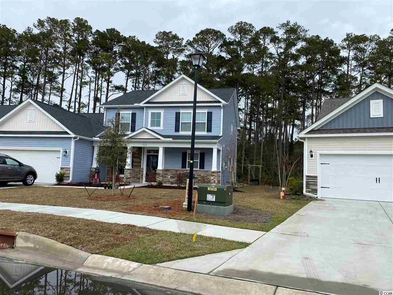 Park Pointe is Realstar Home's new Natural Gas Community.  Located across from the North Myrtle Beach Park and Sports Complex and just off the Robert Edge Parkway, Park Pointe is convenient to everything the north end of the Grand Strand has to offer. Surrounded by nature preserve, Park Pointe offers a tranquil, inviting backdrop for your new home.  Park Pointe allows easy access to major highways like Hwy 31, Hwy 90, Hwy 17 and N. Myrtle Beach's Main Street. You can live minutes to beautiful beaches, fabulous shopping, championship golf, great restaurants, amazing night-life, first-class medical facilities and other local attractions...in other words, it's everything you're looking for in a Coastal Carolina location.  With 13 open and uniquely designed plans ranging from 1360 heated sq. ft. to over 3000 heated sq. ft., these well-appointed homes offer a tremendous selection of options.  Next door you'll find the North Myrtle Beach Park and Sports Complex.  The park is equipped with a wide selection of amenities that will add value, fun, and comfort such as concessions, picnic shelters, playgrounds, an amphitheater, walking/bike trails, dog parks, a 25 acre lake for water activities, a 10 acre meadow and much more.  Enjoy everything that North Myrtle Beach and Little River has to offer when you make Park Pointe your place to make memories happen.  *Photos are of model with additional upgrades*