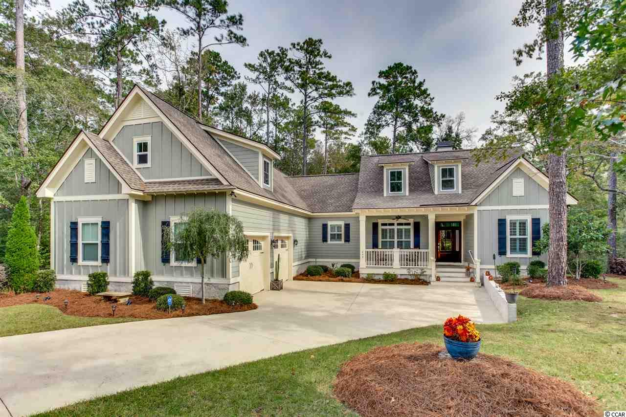 Home is located in the best of both worlds. Retail stores, beach, Marsh Walk are all within a few miles and the sanctuary and the world of nature is in your own back yard with birds, owls, turkey and deer. Enjoy your Cul-de-sac lot which backs up to wetlands. (You may want to get a dock permit and a kayak or small boat! Less than 700 feet from the edge of grass in your back yard to the water line.) This delightful, quality constructed home has features galore! From the exterior finishing touch of Hardy Plank siding, Oyster Shell chimney and foundation to custom interior finishes, it's all the special things people do to make a home unique. These homeowners went as far as adding a whole house generator and water filtration system. You have unique solid wood flooring in the wide-open living space. Comfy, light carpeting in bedrooms. The unusual lighting fixtures, custom cabinets, wainscot accent trim, are some of the features throughout. Plantation shutters on interior front windows and bedrooms. Natural slate wall gas fireplace warms you as you surround yourselves in the open space of the natural light on a sunny day. Amidst the beautifully custom designed kitchen, you will find the large gas stove/stainless steel ceiling mount range hood and plenty of cabinets, polished granite countertop and workstation/breakfast bar. Eating area nook allows you to get a great view while dining or go out to the wide screened-in porch and have your morning coffee. Independent tray ceilings present a feeling of separate rooms, yet blend the entire living space together. Substantial master bedroom on one side, large enough to have a sitting area, walk in closets, and a lavish bathroom. Soaking tub and oversized 2 head, luxurious shower area. Split bedroom plan with 2 large bedrooms and a full bath afford the privacy you sometimes crave. A large laundry room offers space to work, plus cabinets galore. A quiet 4th bedroom in the back of the house would make a lovely office or den. Go upstairs to the split-level bonus rooms. Exercise on one side and enjoy a movie night on the other side, lots of possibilities for the use of this space! So much room, so much quality, so little time! Community amenities include but are not limited to The Park Nature Trail, shuffleboard court and horseshoe pit, basketball, swimming pool.  Don't miss out in this seller's market, Call today for your private tour!