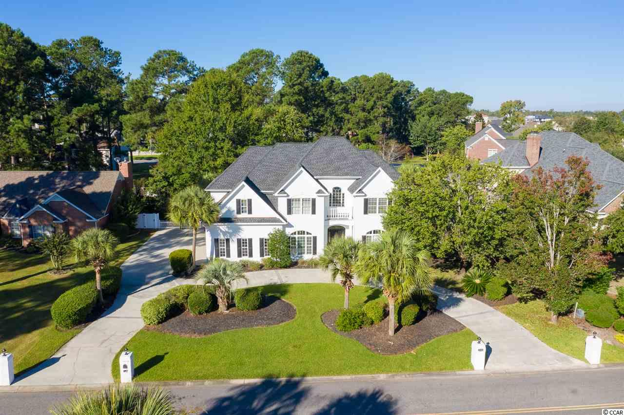 What a Rare Opportunity to own this gorgeous all brick 5 bedroom 4.5 bath home on a .44 acre lot with a huge pool , 3 car garage,  tons of parking for RV , Boat, Jet skis, golf cart etc. This home is located in one of the most desirable neighborhoods in Myrtle Beach with NO HOA. This home has a new roof , new HVAC, all bathrooms and kitchen have been updated, new hardwood tile flooring downstairs, all new carpet in bedrooms and huge downstairs room perfect for playroom, office or gym, new interior and exterior paint, new pool liner. The two story foyer meets you with a grand staircase , gorgeous formal dining room,  a screen porch off the back overlooking your large lot and pool completely fenced in and private. This home has a guest suite with it's own entrance to the home and a porch perfect for rocking. The Master suite is gigantic with trey ceiling, fireplace, huge sitting room off master, extra large walk-in custom closet, steam shower and gorgeous soaking tub. The laundry room is upstairs as well for extra convenience. The kitchen has new stainless steel appliances, a sub zero refrigerator, gorgeous white cabinets and stunning white shadow storm granite. Plantation Point is centrally located near everything, ride your golf cart to the beach or the Grande Dunes Marina for a boat ride. This home truly has it all and will not last !