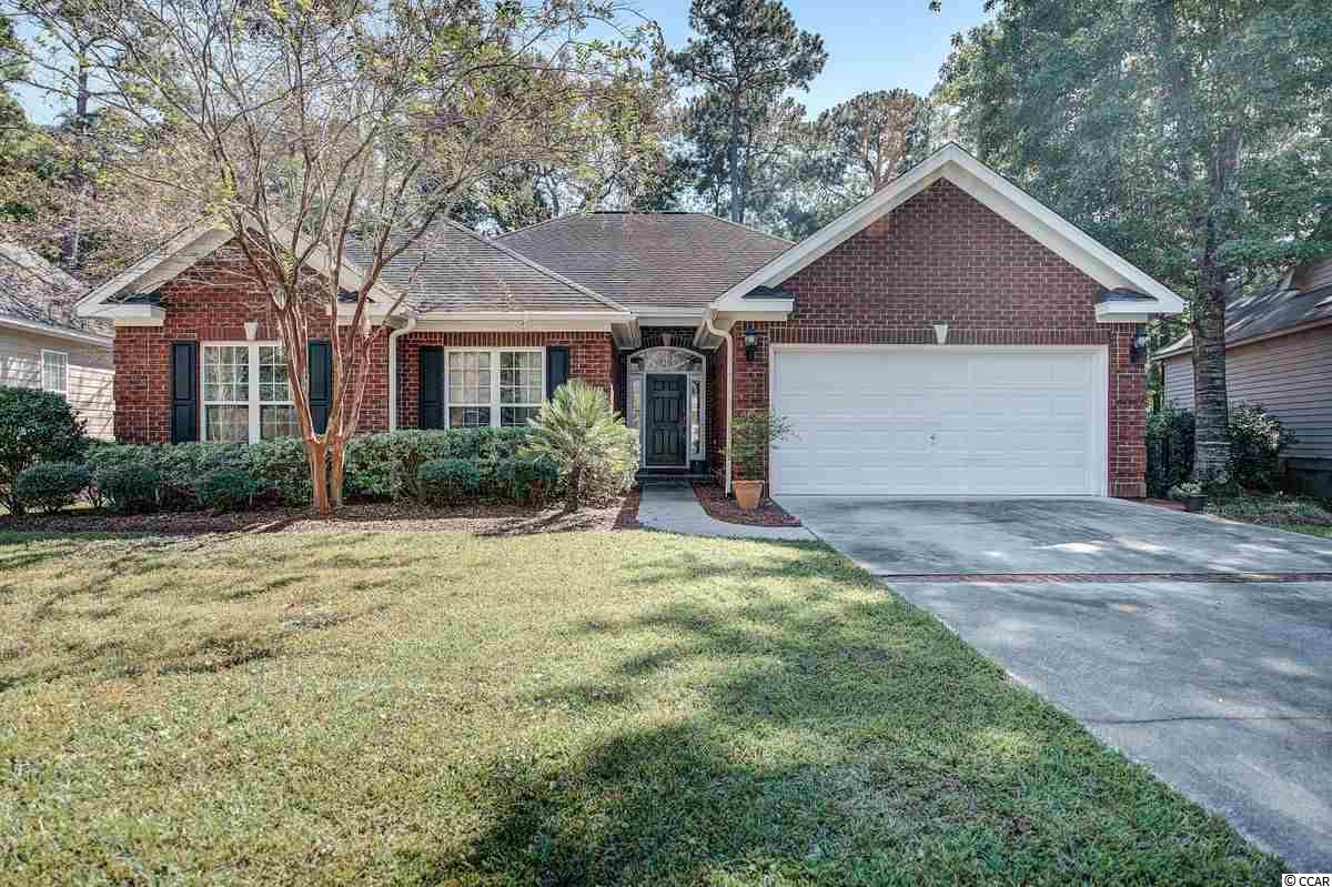 Enjoy golf and lake views while still maintaining privacy as the house sits back unnoticed from the golf course side.  Located near the end of the street with quick access in and out making it easy to enjoy all local fun and shopping. Location is ideal.  The house has a very large open area that flows from the dining area through the kitchen and into the den and Carolina Room.  A few bonuses include all brick and an HVAC that is only a little over a year old.  Pawleys Plantation offers many amenities and low HOA fees with the Jack Nicklaus signature golf course to challenge you regularly.  If golf isn't your thing, there are lots of other community sponsored things to do.  Charleston, Myrtle Beach and Historic Georgetown are nearby.  Spend the day on our wide local beaches or exploring 5 rivers.  There are numerous social events for entertainment and wonderful parks to explore.  Seize the opportunity to live in Pawleys Island.