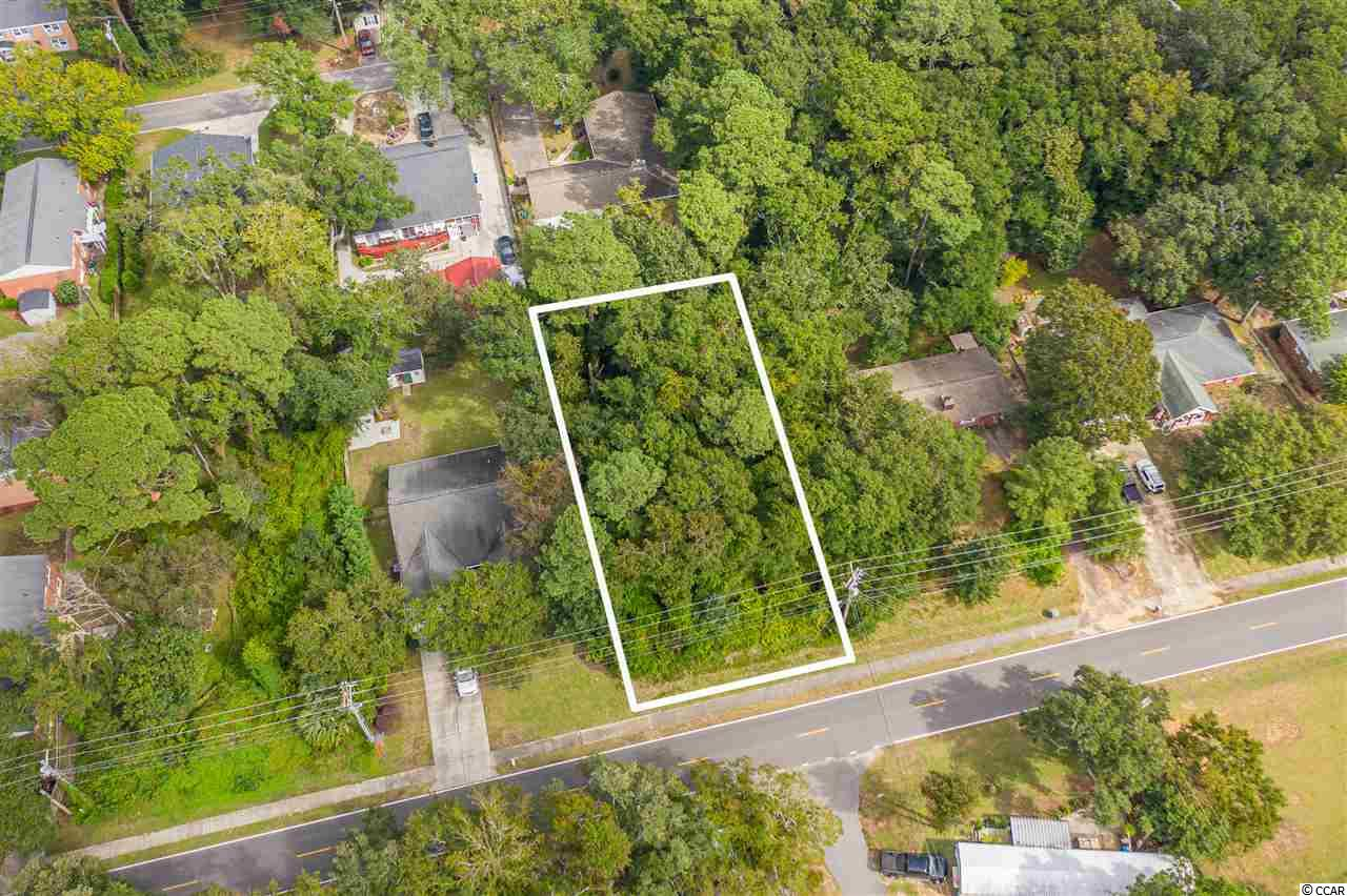 Great opportunity to purchase a large home site on the ocean side of Hwy 17, with a straight shot to the beach.  You can build your dream house!  Close to shopping, great restaurants, and the sandy shores of the Atlantic Ocean.  Best of all this land is NOT in a flood zone!  Come see this great lot before it's gone!