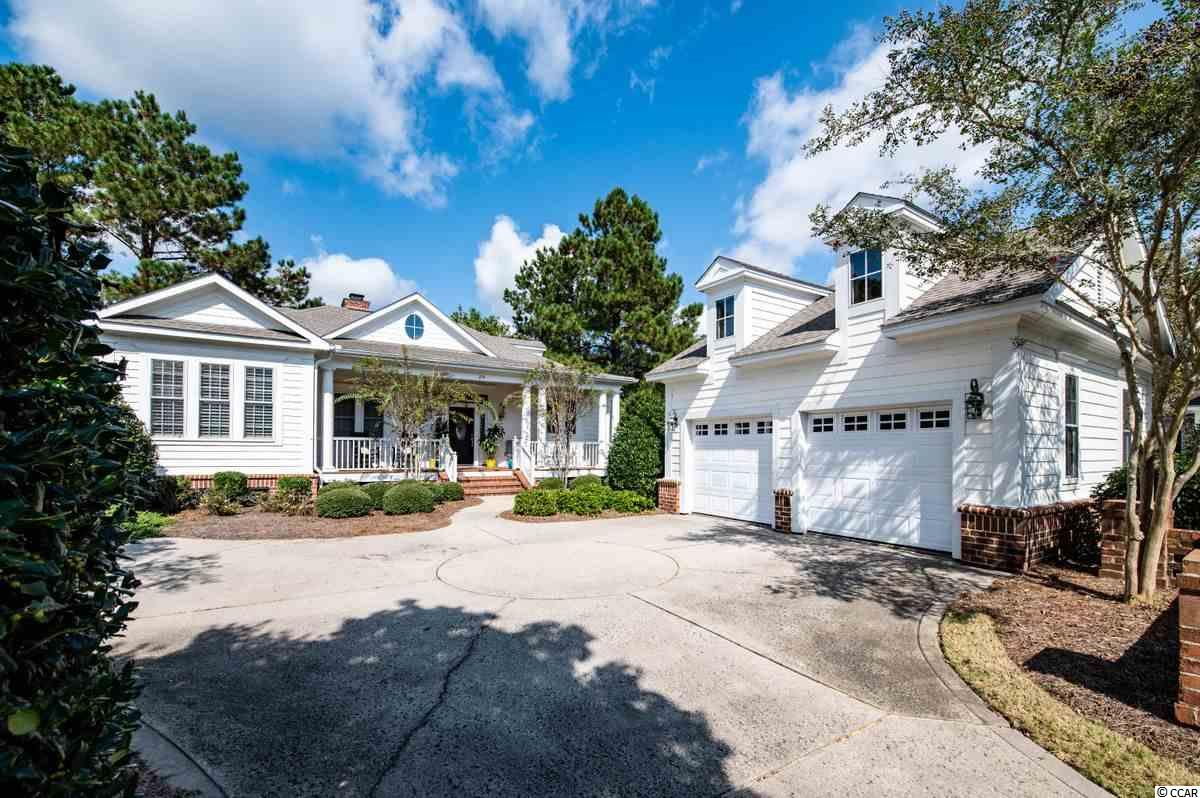 This exquisitely built and beautifully furnished 3BR/3BA cottage style home, with its lusciously landscaped surroundings, has the flair of a Lowcountry paradise. Sit and relax while enjoying your favorite beverage on the spacious front porch or the newly constructed paver patio with panoramic views on the community pond with a fountain.   You will love the stunning details of this perfectly planned Lowcountry style home including open floor plan, vaulted ceiling, fireplace and  carolina room. You will also be pleased to see a newly updated, well-appointed kitchen that features lovely farmhouse sink, quartz countertops and ceramic backsplash. The lovely cottage kitchen also boasts stainless appliances, all white cabinets, breakfast bar, work island and built-in desk workspace. You will also be pleased with the spacious master bedroom that includes a walk-in closet and opens out to the sunroom. The  master bath offers double sinks, walk-in shower and large garden tub. You may want to spend the best part of the day in the Carolina Room with large windows and transoms that offer amazing views of the back paver patio and large community pond with fountain. There are many more recent updates to this home including new roof, new Smart Heat Pump w/air purification, new hot water heater, water filtration system, tiled shower in bathroom #2 and vanity top in bathroom #3.  In the detached garage, you will find  parking space and storage space for beach toys such as, surfboards, kayaks, golf cart, etc. There is also an automatic lawn sprinkler system.  The Reserve, a private gated neighborhood within the Litchfield community,  can be found nestled in between the Atlantic Ocean and Waccamaw River. Just a short golf cart or bike ride away, the residents of The Reserve are able to enjoy private beach access, parking, beach clubhouse available to rent for special events in addition to walking/biking trails, tennis courts, and a fishing pier at Litchfield by the Sea. This lovely pro