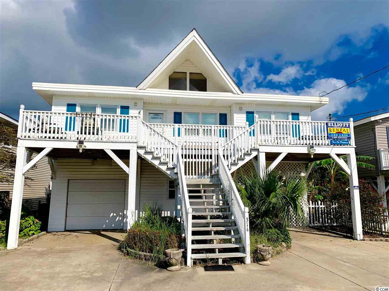 This is a hard to find Cherry Grove raised beach home with 4 bedrooms and 2 baths on the top floor.  The bottom floor presents an opportunity for potential buyers since it has a living room with tile floor, kitchen, bedroom, and full bath on the ground level that is heated and cooled.  This gives the home a 5th bedroom for larger families, older adults, kids, and even pets. This home is a short walking distance to the beach and includes a private dock.