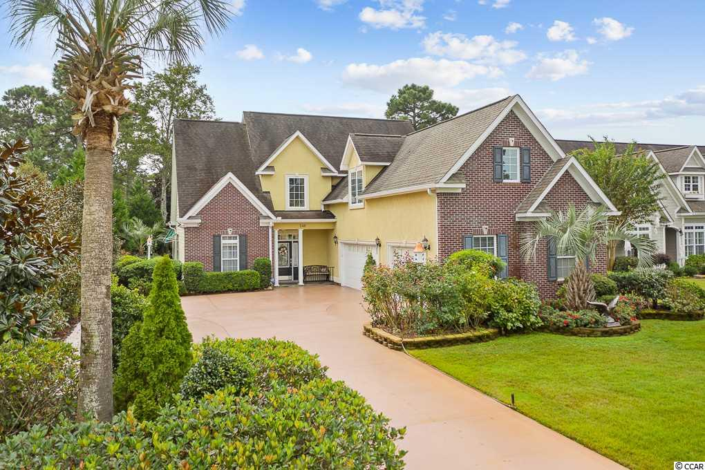 Welcome home to this stunning 4 bedroom, 2.5 bath home with bonus room located in the desirable Plantation Lakes subdivision in Myrtle Beach. This home has been well maintained and is better than new! The extended driveway leads to the 3 car garage and front porch. Walk through the front door and be greeted by a tile foyer and the formal dining room with a vaulted ceiling and wainscoting to the left upon entry. The dining room opens to the kitchen and it features granite countertops, custom tile floors, plenty of cabinets, a back splash, and stainless steel appliances.  This overlooks the breakfast nook which then leads back to the formal living area or the 18x22 sunroom. This sunroom has a mini split air conditioner and heat unit and can be enjoyed during all of the seasons. The living room is cozy and has hardwood floors and a gas vented fireplace. The spacious owners' suite is on the first floor and has both a tile shower and soaking tub along with granite countertops, double sinks, and a walk-in closet. The laundry room and half bath are also on the first floor. The stairs are hardwood and have beautiful wrought iron spindles. Upstairs, be greeted by French doors that open to a bedroom which could also be utilized as a library or office. There are 3 bedrooms upstairs that all have walk-in closets and ceiling fans. The bonus room (12x25) is large and offers many different options for use. There is attic storage access and a separate 15x20 storage area that can be entered through this bonus room or a separate entrance downstairs in the 3 car garage! This is one of the many features that make this home unique and practical for ample storage opportunities. The home has a whole house surge protector feature and tankless hot water heater. Enter the private backyard oasis from the sunroom or outside walkway and enjoy sitting outside under the pergola or under the retractable awning. The landscaping is mature  and lower maintenance. There is an irrigation meter that is separate from the home meter and can water the grass and plants routinely. The 3 car garage features 830 square feet of ample space to park cars, tools, toys and boxes. The driveway has been custom finished and provides additional space for cars. Plantation Lakes residents have access to two community pools, a private clubhouse, playground, tennis and basketball courts and well maintained roads and common areas. This home is a short 8 mile drive to the beach, short drive to the airport, shopping, dining, entertainment, schools, and plenty of golf courses. Schedule your showing of this immaculate gem today.