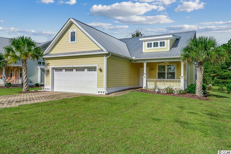 Low country charm in the natural gas community of Oak Hampton. Don't miss this immaculate cottage on the cusp of the Prince Creek area. The paver driveway-sidewalk, Hardie Plank and metal roof hint to the quality inside. The gracious, covered front porch(with a cedar ceiling)welcomes all into this elegant, light and bright home. The custom wainscoting highlights the coastal flair and complements the great room's vaulted ceiling and gas fireplace. Never be cut off from your family and friends while you cook again. This gourmet kitchen, open to the entire great room features custom cabinetry, granite countertops, stainless steel appliances, an oversized breakfast bar and pantry. A bay-windowed breakfast nook offers yet another place to dine and entertain. The private master bedroom boasts a walk-in shower, granite vanity with double sinks and a walk-in closet. Two additional bedrooms have their own hallway and full bath close to the laundry room. The large screened porch(with a cedar ceiling) overlooks a lovely pond complete with swans and other waterfowl. All this plus a fantastic location with the TPC Golf course, Dustin Johnson's Golf Academy and shopping around the corner. More restaurants, the Marsh Walk, Brookgreen Gardens, Garden City and the beaches are just minutes away. Measurements to be verified by the buyer.