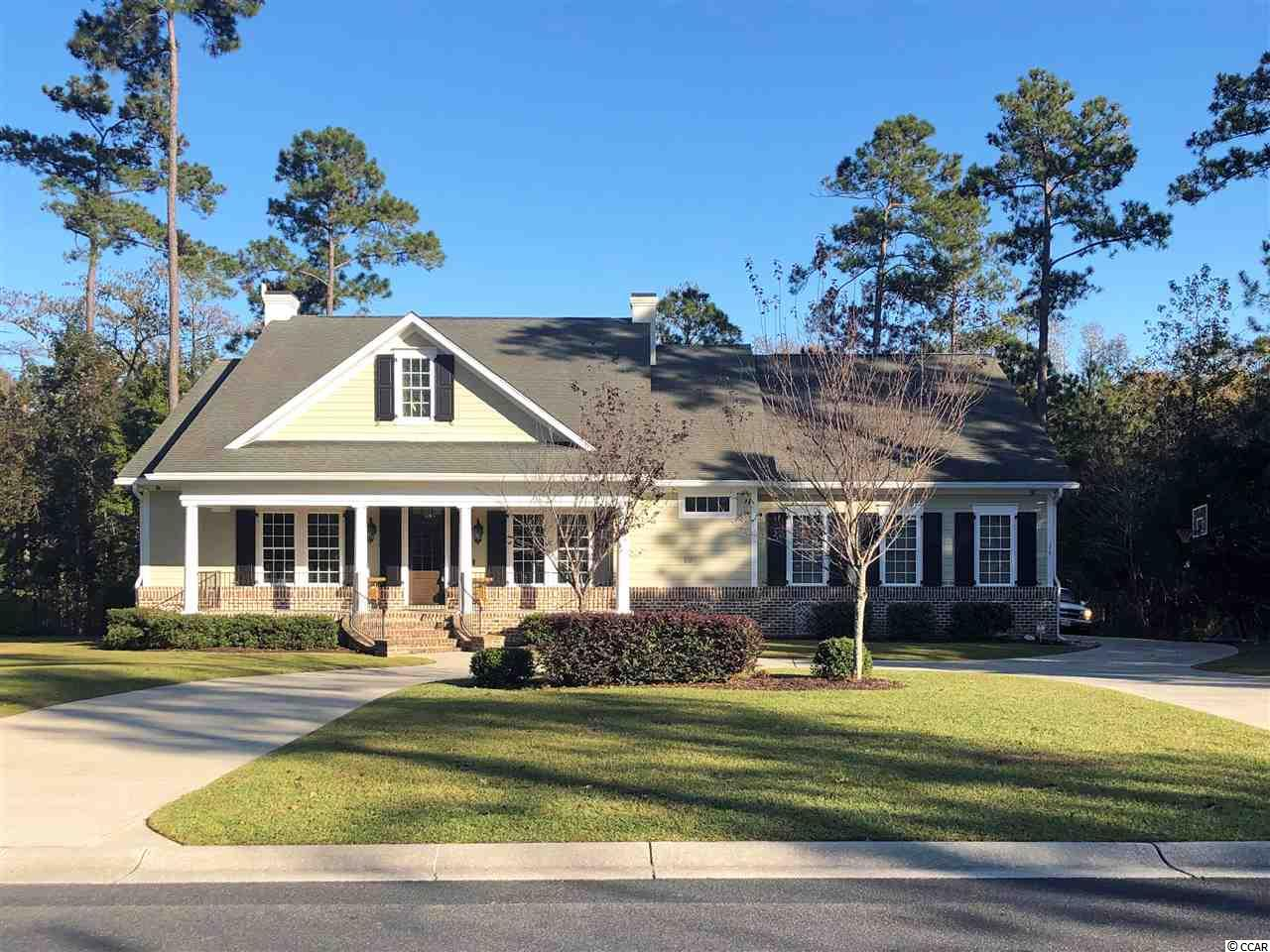 Beautiful low country home with private frontage on Collins Creek which leads to the Waccamaw River as well as private saltwater pool. This single-level, 4 bedroom (possible 5 bdrm), 3 bath home with office boasts an open floor plan with abundant natural light. Gorgeous eat-in kitchen and formal dining room. Just off the large foyer is the light-filled study with custom built-ins. Spacious, climate-controlled sunroom with wet bar overlooks the pool. Split floor plan design provides privacy to the master suite. Hardwood flooring and custom closets throughout. Circular drive and side-loading garage. The gated community of Bellwood Landing provides residents with access to the Price Creek West amenity center with pool and kiddie pool, tennis courts, playground, grilling area, walking trails and more. Only minutes from beautiful beaches and convenient to schools, medical facilities, restaurants and shopping.