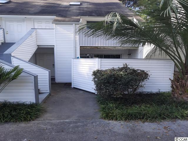 Come see this 1 br 1 bath 1st floor end unit furnished. Close to beach and shopping. Featuring open floor plan, fenced front patio and unit backs up to wooded area.