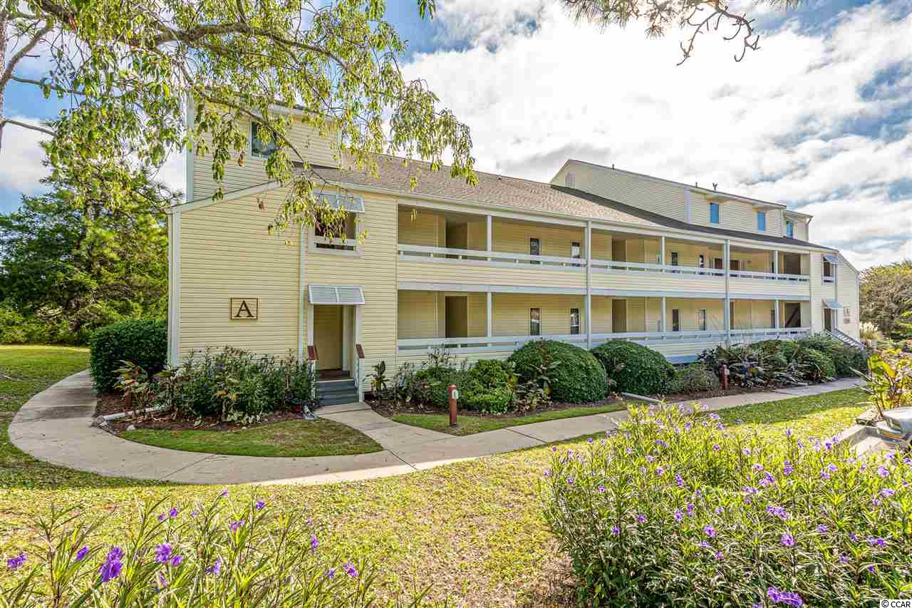 This is a first floor end unit condo being sold fully furnished in the lovely community of NMB Golf and Tennis. It is a 1 bedroom 1.5 bath unit that is well kept and only used as a secondary home. There are two sliding glass doors in the living room that lead to a large outdoor porch facing the tennis courts. This condo complex offers an outdoor swimming pool, tennis courts, and a grill area. Plus it is only a golf cart ride to the ocean! There are even numerous restaurants and shops close by making this location extremely convenient.