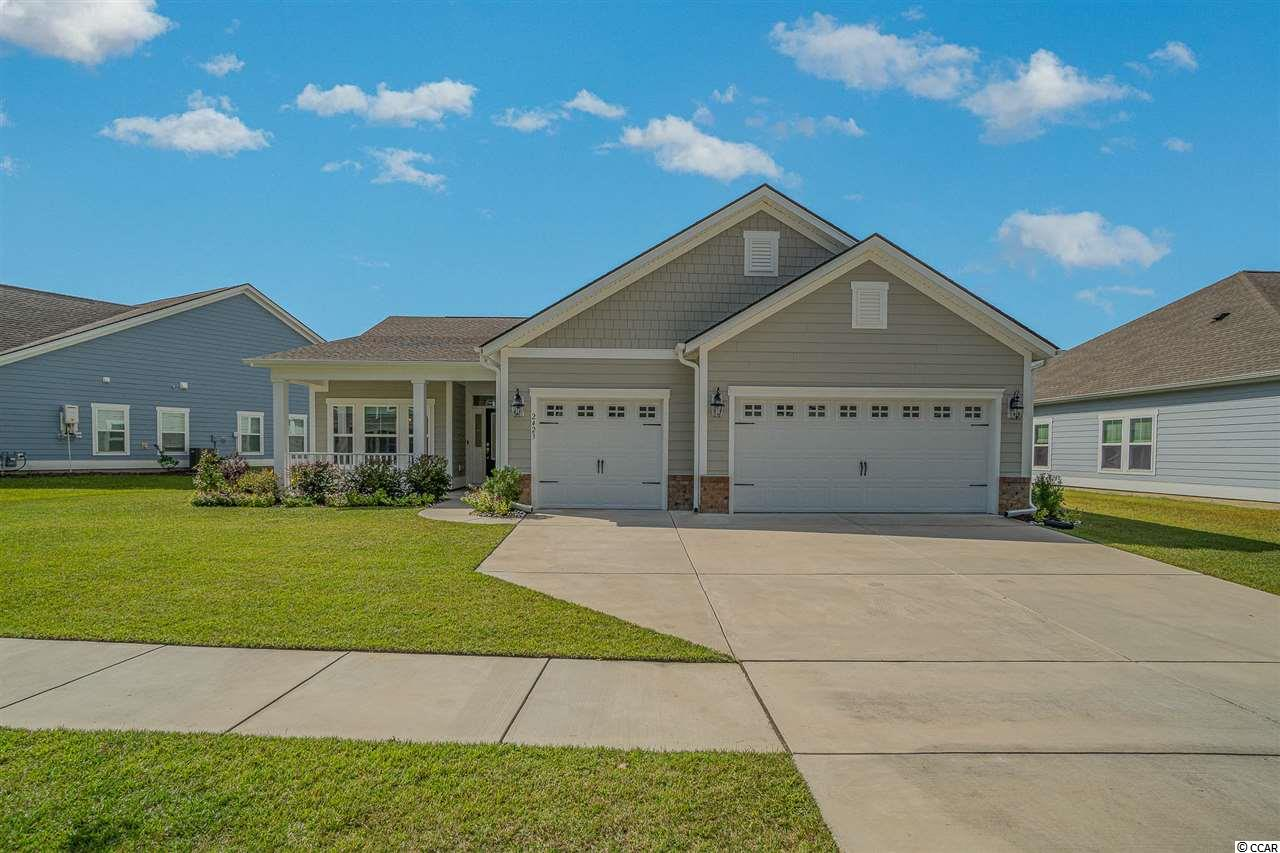 MOVE IN READY... Welcome to Coastal Living at its finest! Located just a quick golf cart ride to the beach, in Myrtle Beach's incredibly popular location of Bell Harbor at Market Commons! This 3 bedroom, 2 bath beauty is a home buyers dream home!!  This model floor plan has everything on your checklist and more. From all the modern touches throughout the house to the spacious master bedroom with its large ensuite, a 3 car garage and a magnificent waterfront backyard view, this gorgeous home will make you swoon with excitement and daydream about celebrating the holidays in style! The open floor plan has plenty of space to entertain and includes an inviting fireplace centered in the main living area. This home has been meticulously cared for inside and out, so come check out its wonderful manicured lawn and then take a golf cart ride and enjoy all the amenities this development and Market Commons location has to offer! This beauty won't last long and just one signature away from being scooped up for its future family to enjoy!