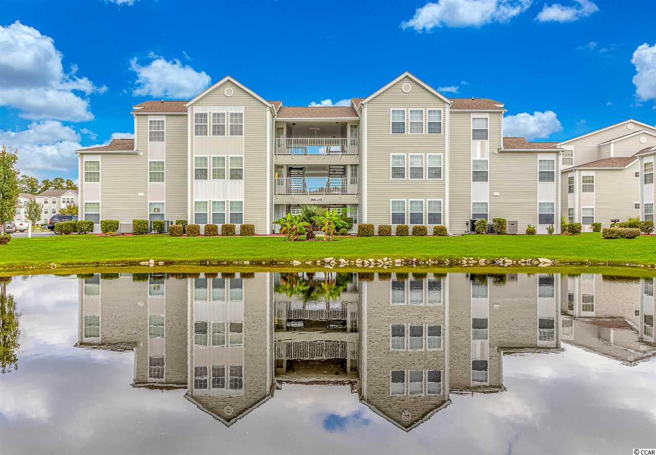 Nice two bedroom 2 bath with Carolina room overlooking the lake in Southbridge, Full time grounds keeper, community pool. Security Camera. Great location very nice first floor unit.