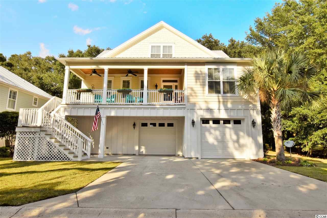 "Holy Wahoo, this is one to brag about ! If you are ready to live the Inlet Life to it's fullest potential.. here is your opportunity to get started. Boasting over 4,000 total square feet under roof, 21 Flagg Point Lane offers so much more than just a great location and good looks. From the moment you drive up, there is no doubt you will be smitten! The main living area features an open floor plan adorned with crown molding throughout, a full laundry room, true master suite offering plenty of closet space, and spacious screened in porch overlooking centuries old live oak trees. The classic kitchen, also on the main level, offers granite counters, GAS RANGE, stainless appliances, semi-custom cabinetry, and an eat-in area. There are two over-sized guest bedrooms , each with a private bath, located on the top floor conveniently spaced by a "" 2nd living area "" perfect for visitors. The Ground floor hosts a full bar / entertainment area and generous four seasons room overlooking the serene back yard. ( NOTE : The entertainment area can also be converted to a 4th bedroom at the seller's expense if desired ) . Additional upgrades include   dual-hvac, instant hot water, and much more! Flaggpoint is a quaint Community houses only 13 home-sites situated in the Heart of The Inlet and adjacent to The Murrells Inlet Marshwalk. Flaggpoint also features a private "" Mini-Marina "" for residents only ( Boat Launch and Day Dock ) with direct 24 hour / deep water access into the Inlet ."