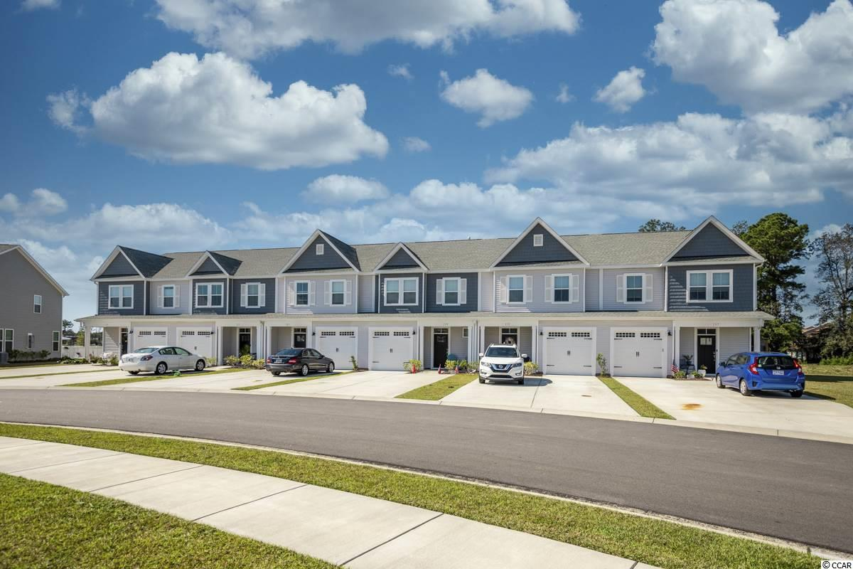 Location, Location, Location!! This is a gorgeous 3 Bedroom, 2.5 Bath, 2-story Townhouse in the Bridgewater Community in Little River. Built in 2019, it offers approx. 1586 heated sq. ft. of living space a Garage and Low monthly HOA payments. A covered Front Porch welcomes you to the home. Inside the Foyer greets you as you enter the open Living/Dining and Kitchen areas. The Kitchen area is Fabulous with Recessed Lights, beautiful tiled Backsplash, Stainless Steel Appliances, (Range, Fridge, Dishwasher, Microwave) Granite Counters, beautiful high-quality staggered Cabinets, a Work Island/Breakfast Bar with electricity and Pendant Lighting over the area. The large Master Suite has a beautiful Tray Ceiling and Fan. The Master Bath has a great walk-in Shower and a Vanity with 2 Sinks. The other 2 Bedrooms are large as well. The house has many Builder Upgrades: high end distressed wood laminate Floors, new Carpet, a gas & tankless Water Heater, Keyless Door Entry, Video Security System, a Privacy Fence, T2 attic storage area (one on 1st floor level and the other in the attic plus a Premium Lake Lot that comes with a gorgeous sunset! ~Under a separate Bill of Sale, all of the Furniture plus the Washer & Dryer can be purchased.