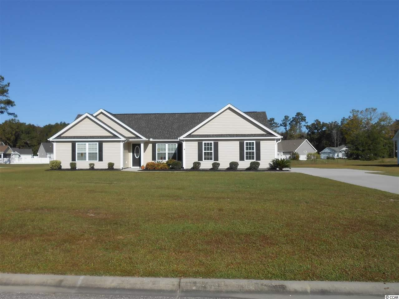 Immaculate one owner 3 bedroom, 2 bath, home in Yauhannah Landing which is a gated Community with 70 homes on large 1/2+ acre lots. The home is on a premium pond lot with a fenced backyard. The living room and kitchen have vaulted ceilings and the master bedroom has a tray ceiling.  The interior walls have been painted.  The sliding doors in the dining area provide access to the 14' X 10' covered rear porch which has a ceiling fan and overlooks the pond.  The home has rain gutters.  The side entry tandem 2 car garage has an additional 14' X 10' bay which could be used for a 3rd vehicle, a workshop, a boat, etc.  The garage also has 2 windows and drop down stairs for storage above the garage.  Launch your boat from the private Community owned boat ramp!  Don't miss out on this beauty! All measurements and square footage are approximate and not guaranteed. Buyer is responsible for verification.