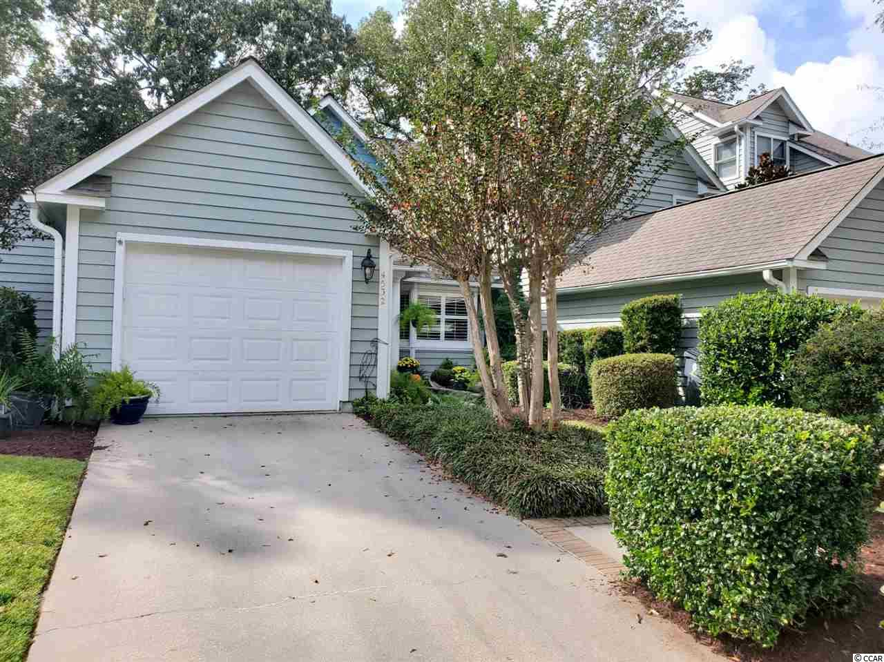 Immediately relax as you step in the door of this immaculate and well loved home. It features a fully equipped kitchen with breakfast/ dining space or if you prefer a more formal look can set up as living room/dining room combination. LR has spacious cathedral ceiling for that great open feeling and looks out on the popular Eastport golf course. Plantation shutters are throughout home for your enjoyment. The rear patio and covered front porch allow you to enjoy the outdoors rain or shine. Spacious master bedroom includes en-suite and walk in closet as well as a  ceiling fan and you have an additional spacious guest bedroom. In the attached garage  you will find an extra-wide pull down attic with aluminum steps. Call for your appointment today