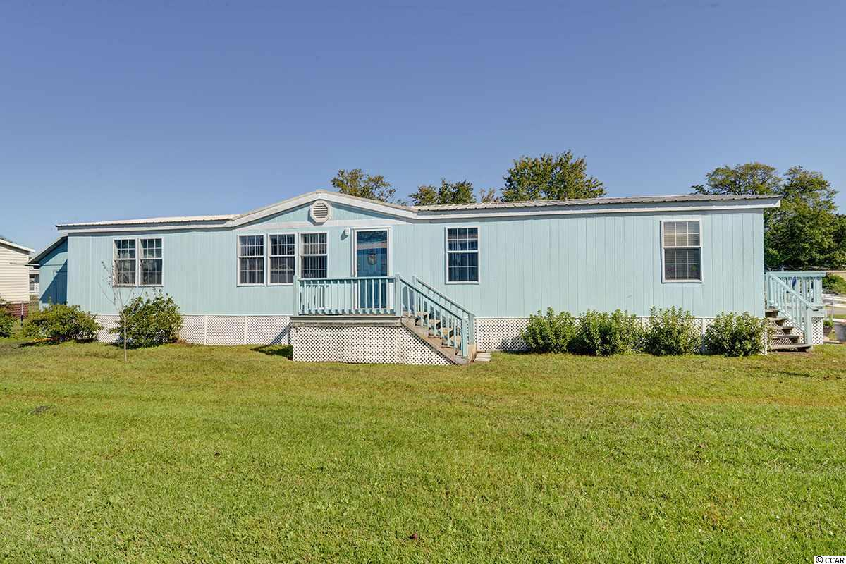 Location, Location, Location! Absolutely Stunning Murrells Inlet Home just hit the market in the Captain's Cove Community just a few miles North of Pawley's and a Stone's throw to the popular Inlet Marshwalk! This beautiful coastal home features 4 bedrooms, 2 bathrooms and 1,500 sq ft of indoor living space and much more of outdoor living fun with a massive screened in porch and a total 4, YES 4 outdoor patios!!!! The floor plan features a beautiful kitchen, a massive dining room onlooking one of the patios, a spacious living room, a massive master and very spacious bedrooms. This double wide feels like a stick built home with its high ceilings updated fans & fixtures, sheet rock throughout, bright windows and durable vinyl flooring that resemble hardwoods. The kitchen comes equipped with gorgeous cabinetry and stainless steel appliances, plenty of counter space, and a very spacious laundry room. This amazing coastal style double wide also boasts a split bedroom and bathroom layout for the convenience of out of town guests or multigenerational living. During the summer, entertain in style on one of the many decks or relax near the sparkling community pool or head to the Inlet and grab a bite to eat at one of our many Water Front Dining Experiences. This home also comes equipped with a 2 car parking space for private parking and a massive aluminum ramp for our elderly guests or future loved ones. There's a shed in the back for your gardening needs and a partially fenced in back yard for your furry friends! All furniture, and appliances to convey with purchase of the home! This is a must see if you want your desired location at an affordable price! Located in the highly coveted Coastal town of Murrells Inlet. Call today to schedule an appointment to come see it, very motivated sellers!