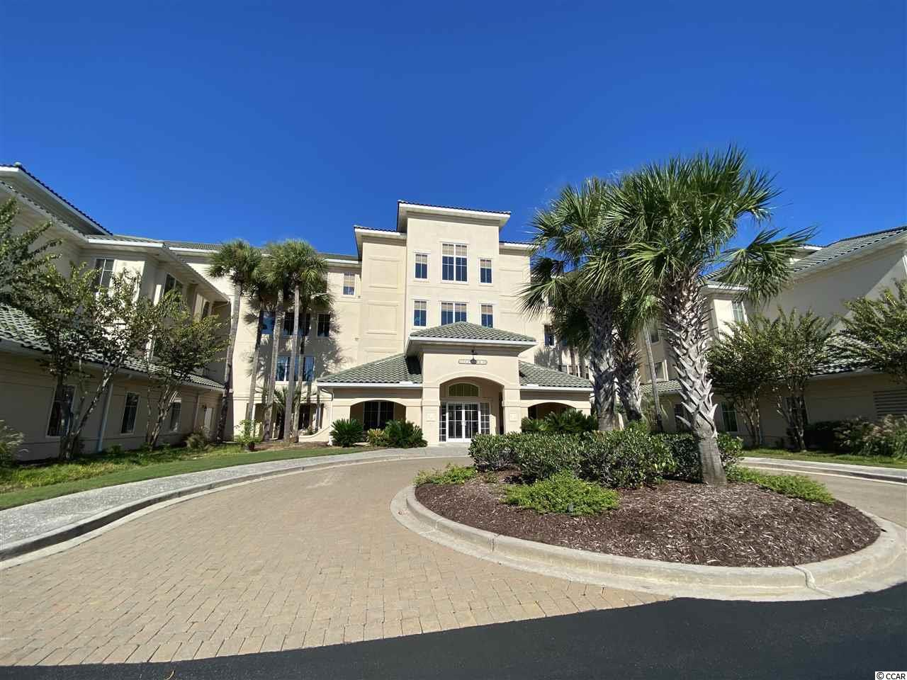 Stunning first floor, 3 bedroom, 2 bath condo located in the gated community of Edgewater at Barefoot Resort. As you walk through the front door, you are greeted by open concept living.  The eat in, U shaped kitchen, with stainless steel appliances, pantry, granite counter tops and a breakfast bar all overlook the dining and living rooms.  The dining room is perfect for fancy meals or to host a dinner party.  The living room boasts tray ceilings and glass doors letting the natural light pour in.  Take in the view of the 15th hole of the award winning Norman golf course form your private 4 season enclosed balcony.  Back inside the master bedroom suite has a tray ceiling, two walk-in closets and a spa bathroom.  Relax in your master bathroom with dual vanities, oversized jetted tub, walk in shower and tray ceiling.  The split bedroom plan allows for guests to have privacy.  The massive second bedroom has a walk-in closet and a vanity area.  A third bedroom and guest bathroom complete that side of the condo.  This condo also comes equipped with a laundry room, one assigned. parking spot in the garage and one storage unit.  HVAC was replaced in 2018,  Edgewater s a gated community providing privacy and security to all its residents who enjoy many perks, including the clubhouse on the Waterway, with a fitness facility, pool, hot tub, walking path along the water and day docks.  Edgewater is located in the prestigious Barefoot Resort which also has extraordinary amenities.  As a Barefoot Resort homeowner, you will have access to the private beach cabana with parking, 4 award winning signature golf courses, driving range and 2 multi-million club houses.