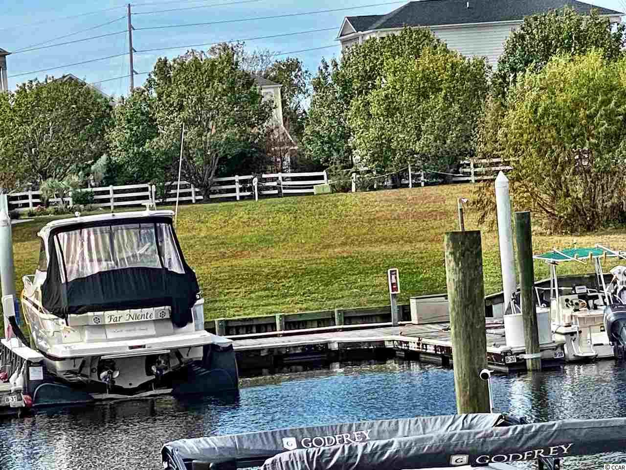 Waterfront lot at the prestigious waterway community of Marina Bay.  This premier waterfront lot is cleared, high and dry with 64' of water frontage and ready for you to build your  dream home in the best location in North Myrtle Beach. You will love the beautiful views of marina and waterway from the back of your new home!  Golf cart to shopping centers, restaurants, entertainment and the sparkling ocean.  Boat slips are available for sale!  Don't miss out!!