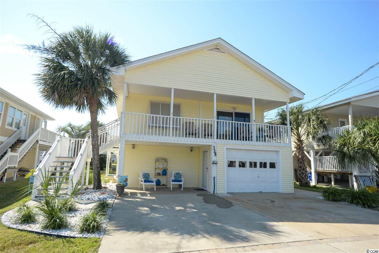 Wow! Gorgeous, 4 bedroom, 2 bathroom, large Channel Home with amazing views in the Cherry Grove section of North Myrtle Beach with lots of upgrades but still some original charm kept intact. Two living rooms and two kitchens, one of each floor. High ceilings with exposed beams, original hardwood floors, luxury vinyl plank flooring, tile flooring, floored steps, interior access to both floors, granite countertops and updated cabinetry in kitchens and bathroom, icemaker, HVAC only two years old, roof replaced in 2017, ceiling fans in all rooms, great colors, large decks on front and back, dock and floating dock on a wide channel. Great for a primary residence, second home or rental investment. All these great features and just 3 short blocks to the beach!