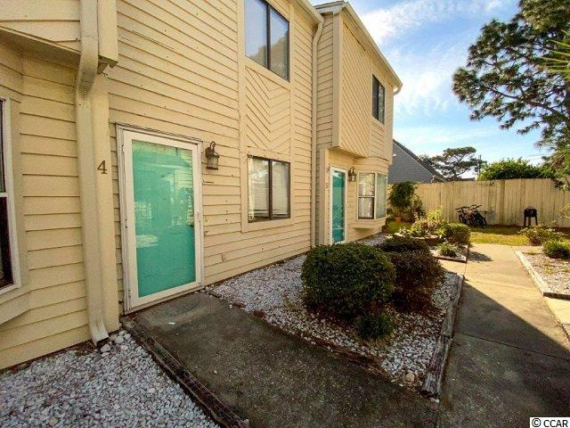 The well located unit is close to all you need.  Shop[ping, eating, beach  with Low HOA dues. You can be east on HWY 17 at a great price.  This two bedroom 1 and half bath.  The unit has been up dated. It has laminate flooring in the bedrooms and living room area.  but carpet on the steps. It is painted a light blue color.   Buyer responsible for verification of measurements.