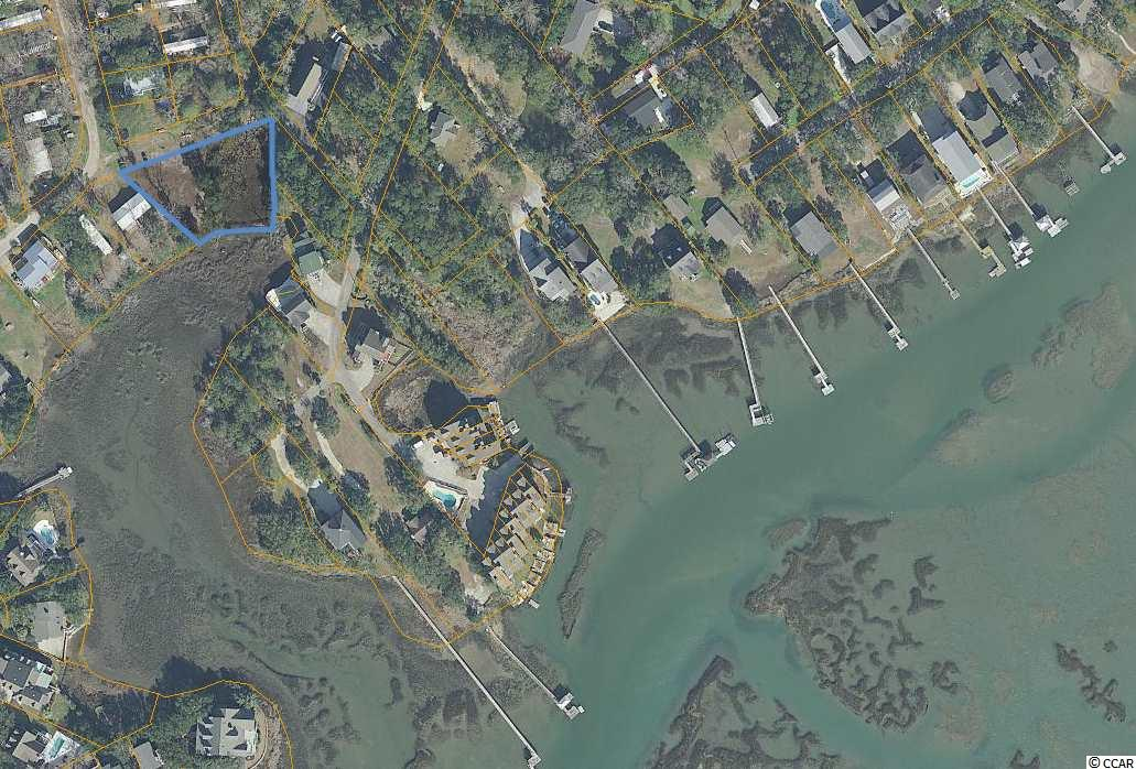Large, cleared homesite in the heart of Murrells Inlet with nearby boat ramp!  There is plenty of room to build your inlet home in this unique location, come take a look and enjoy everything Murrells Inlet has to offer.  See photos for a plat with possible home position.