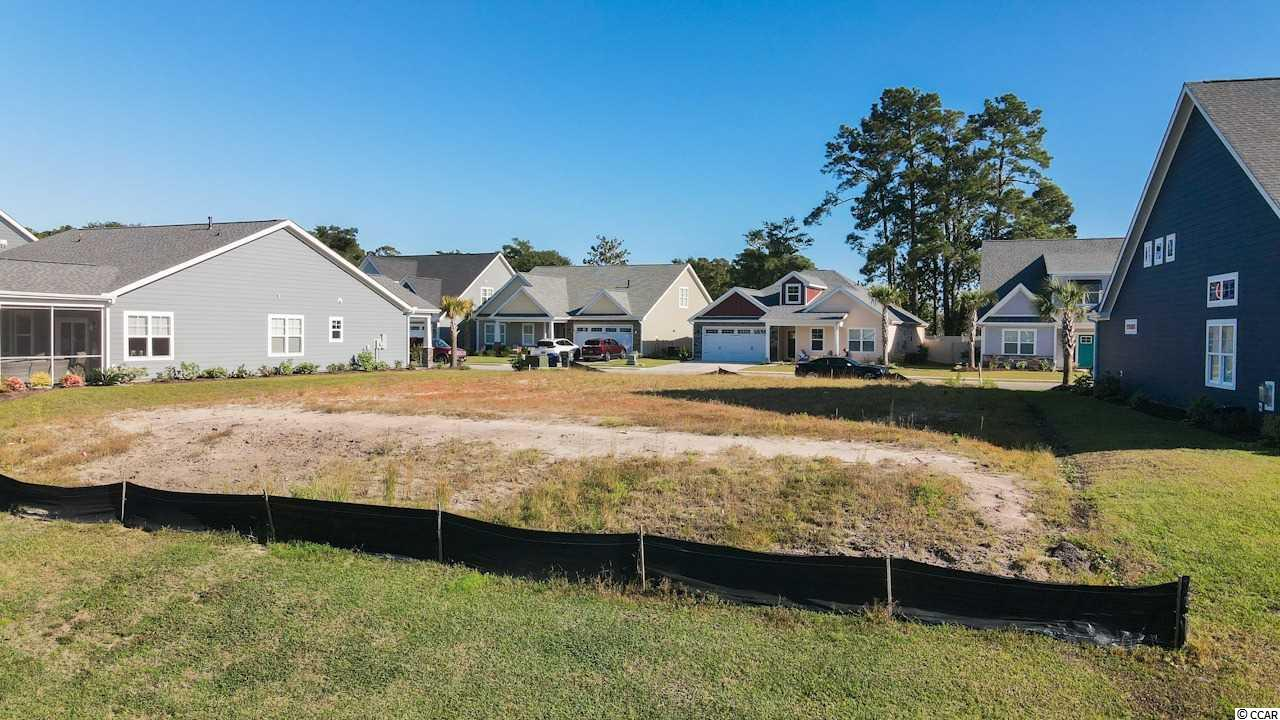This spacious lot is the PERFECT OPPORTUNITY to build your DREAM HOME with stunning water views! Being in the prestigious natural gas community of Robber's Roost at North Myrtle Beach, you are located East of Highway 17 which means you are WALKING DISTANCE TO THE BEACH! You can walk, ride a bicycle, or ride a golf cart to the beach! You are also minutes to Main Street, delicious restaurants, shopping, beautiful golf courses, the Intracoastal Waterway, and so much more! Don't miss the chance to live in paradise!