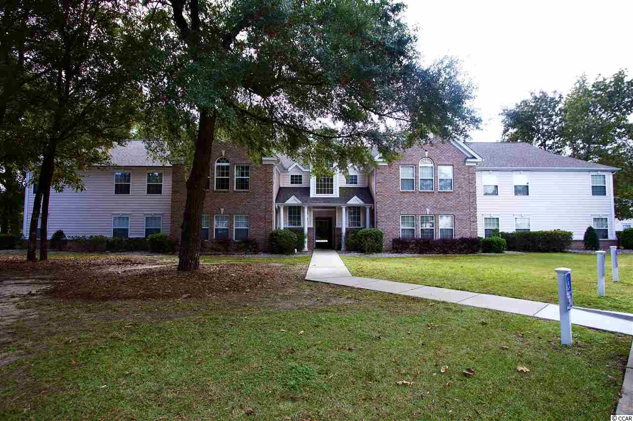 Located in the desirable Riverwood community, this gorgeous 3 bedroom 2 bath condo has wonderful features that make it ideal as either a primary home or a vacation getaway!  Immaculately maintained unit has a great open floor plan with lots of natural light. Features include spacious living room and a large dining area with fully equipped kitchen that boasts plenty of cabinet and counter space plus a breakfast bar. The lovely master suite has a walk in closet plus vanity , garden tub and separate shower. The additional two bedrooms share a bathroom. In addition, there is abundant closet and storage space in addition to a laundry room with washer/dryer. As an added bonus this first floor unit backs up to a private wooded area that is quiet and tranquil. Amenities at Riverwood include an outdoor pool, tennis courts and a clubhouse. Close to restaurants, shopping, golf, Murrells Inlet Marshwalk, Brookgreen Gardens and best of all - the beach! Make an appointment to see this fabulous home today!