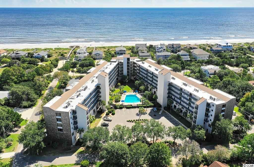 Breathtaking ocean view from balcony. Beautifully updated and appointed top-floor condo boasts a unique residential location within the quiet community of North Litchfield Beach. This three bedroom, two bath condo offers single-level living and comes fully furnished. Luxury wood-look vinyl flooring and ceiling fans throughout. Shiplap cathedral ceilings in living room and master bedroom. Enormous windows and sliding glass doors bring abundant natural light controlled by the new solar shades. Open kitchen boasts quartz counters, stainless steel appliances and raised ceiling. Stacked washer/dryer closet. Assigned covered parking spot and ground level storage locker. New HVAC in Oct 2019. Litchfield Retreat amenities include elevators, beautifully kept grounds, pool, outdoor showers, cook-out area as well as easy beach access via a ramped public boardwalk located directly across the street. Great neighborhood atmosphere. Convenient to shopping and dining. The Waccamaw Bikeway, which passes through North Litchfield Beach, leads to the adjacent Huntington Beach State Park and to nearby BrookGreen Gardens.