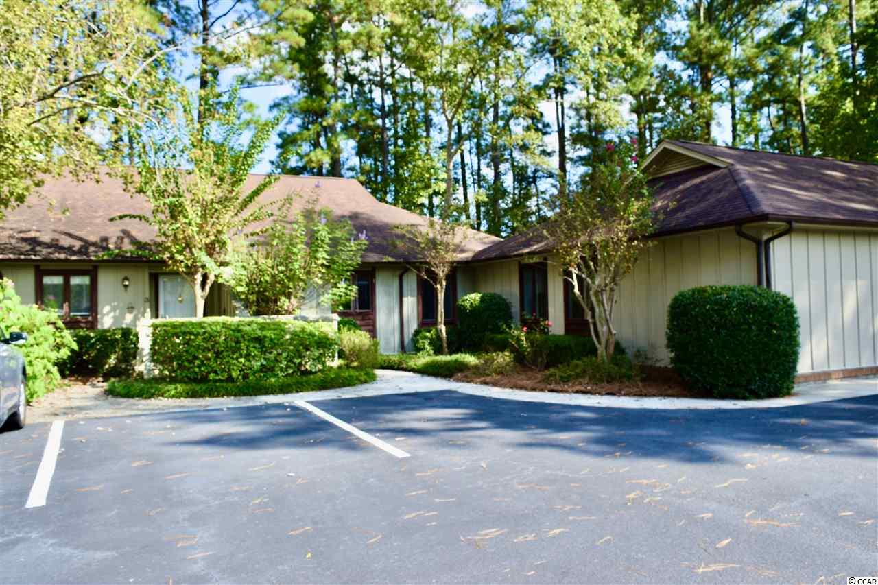 This is a charming one-story cluster townhome in sought after Pawley's Retreat. In very nice and quiet neighborhood. Pawley's Island beaches are just a 5 minute drive away. Pawley's retreat is close to golfing, markets, shopping, and fine dining. This unit offers a large living room and screened in porch.