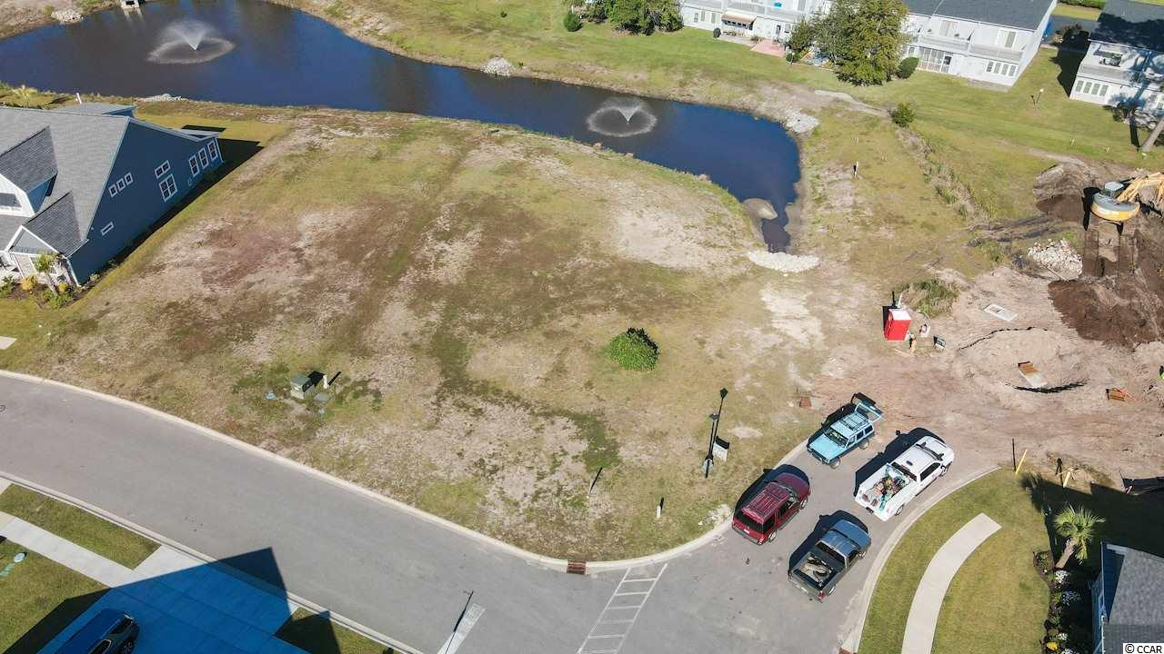 This spacious CORNER lot is the PERFECT OPPORTUNITY to build your DREAM HOME with stunning water views! Being in the prestigious natural gas community of Robber's Roost at North Myrtle Beach, you are located East of Highway 17 which means you are WALKING DISTANCE TO THE BEACH! You can walk, ride a bicycle, or ride a golf cart to the beach! You are also minutes to Main Street, delicious restaurants, shopping, beautiful golf courses, the Intracoastal Waterway, and so much more! Don't miss the chance to live in paradise!