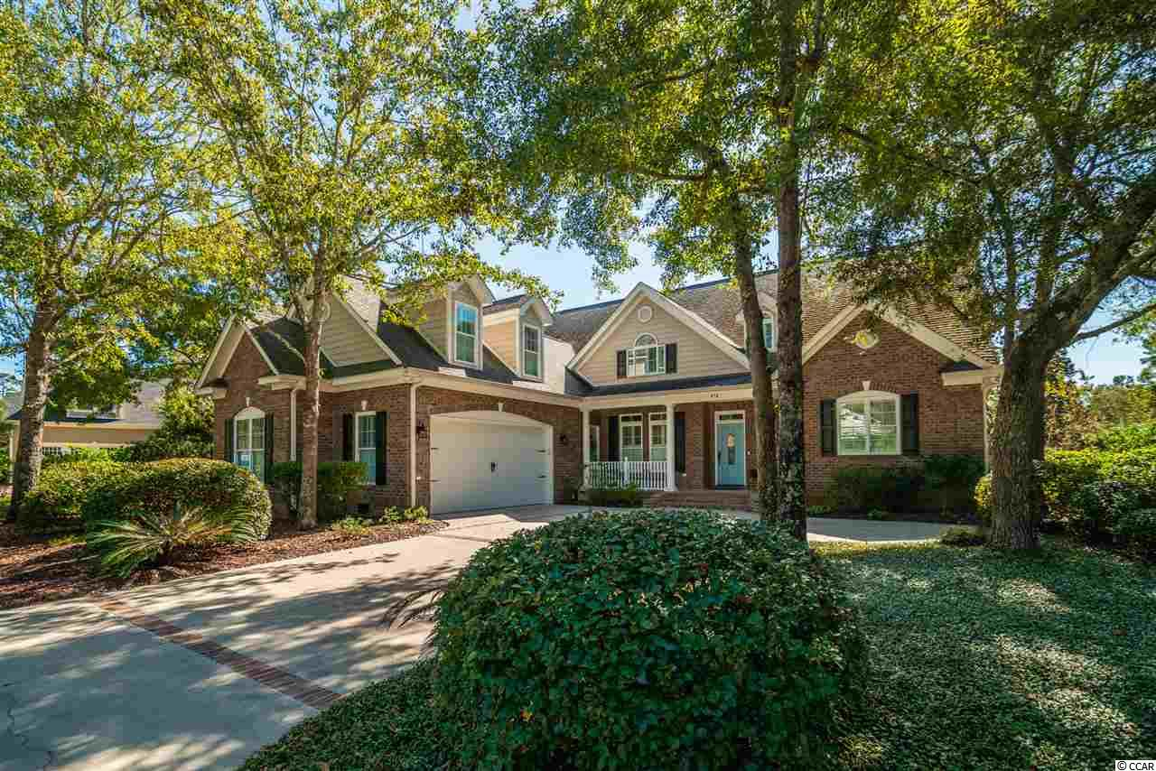 Standing Tall on a Small Hill in The Vintage, this Low Country Brick Stylish Home has it ALL!  Premier Construction, Superior Interior Details, A Fabulous Floorplan, PLUS a Perfect Tranquil Lakefront Setting that will Capture your Dreams.  A Grand Master Bedroom Wing and Guest Suite on the Main Level accommodates very well.  Three additional Bedrooms plus Finished Bonus Room up, provides Spacious Living in Total Comfortable Enjoyment for Family and Friends.  A Custom Gourmet Cooks Kitchen with Large Pantry, Full Wall Entertainment Center with Gas Fireplace, all Solid Wood Interior Doors, Specialty Mouldings and Trims, Finished Storage Galore and Grand Screened Porch show off Exceptional Quality Features.  This residence is situated on a completely Private Corner Homesite surrounded by Mature Landscaping and Shading Trees, incorporating Full length Lake Views with over 100 Feet of Shoreline.  NEW 50 Year Roof to be installed within the next few weeks.  We have you covered with this Excellent Home Ownership Opportunity at The Reserve.  Private Litchfield by the Sea Access Included!!