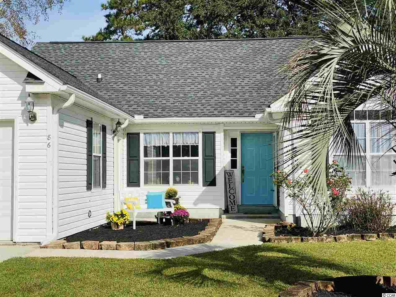 Cute cottage in Wedgefield Plantation, Georgetown, South Carolina!  Split bedroom floor plan with two bedrooms and two baths.  Very bright and open space with room for entertaining inside and out. Vaulted ceilings in great room and dining room, kitchen with breakfast bar and nook - this whole living area looks out onto the HUGE screened porch and separate sun room and then to the  back yard green space of Wedgefield Golf Course #18. Owner's suite with vaulted ceilings and bath with walk-in shower.  Second bedroom and bath are located towards the front of the home.  One car garage and smaller, low maintenance lot.  Wedgefield Plantation is an active and beautiful community with it's own public golf course and a boat landing into the Black River.  Enjoy wonderful dining onsite at The Manor House, an easy golf cart ride away.  Separate memberships available if you so desire - pool, social and golf. Close to historic Georgetown waterfront Harbor Walk, shopping, wonderful restaurants, fresh seafood vendors, and access to five rivers that surround the area with an easy drive to Pawleys Island, the closest public beach access.  *Buyer responsible for verifying square footage.