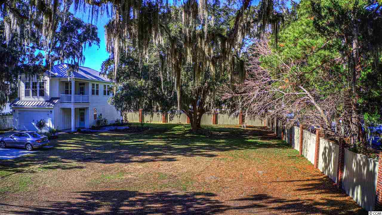 An opportunity for a lot in the gated community of Oak Lea is finally available. This particular lot is in the corner of the neighborhood so you will only have one neighbor and no one directly behind you! The community of Oak Lea is hidden right in the middle of Pawleys Island. It is one of those gems that most people don't know exists! This small quaint, community provides privacy right in the heart of town. Oak Lea offers a swimming pool, tennis court & community dock perfect for launching your kayak, paddle board or simply fishing the day away. Directly in front of the lot stands a majestic oak tree giving you ultimate privacy. On the rear of the lot, there is another beautiful oak tree giving you additional privacy and southern charm. When you build your home, you can build high enough up to have a great view of the marsh and the island. Conveniently located, Historic downtown Charleston is only an hour and a half drive south and Myrtle Beach is 30 minutes north. If you choose to stay close to home, lounge on Pawleys Island, Litchfield Beach, or boat on the river for the day.