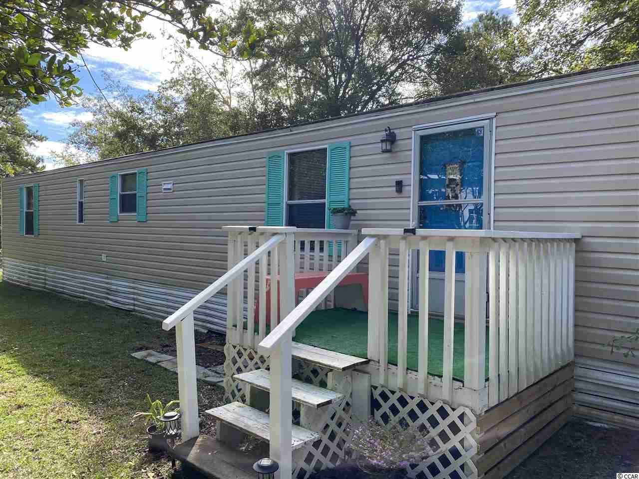 This is a must see if you want part of the beach life. This 3 bedroom, 2 bath home is located just minutes away from all Murrells Inlet has to offer, including beaches, shopping, and attractions. This home features an open concept living area w/ large kitchen and working island. The split floor plan has a spacious master bedroom. All appliances including washer/dryer convey with the purchase.