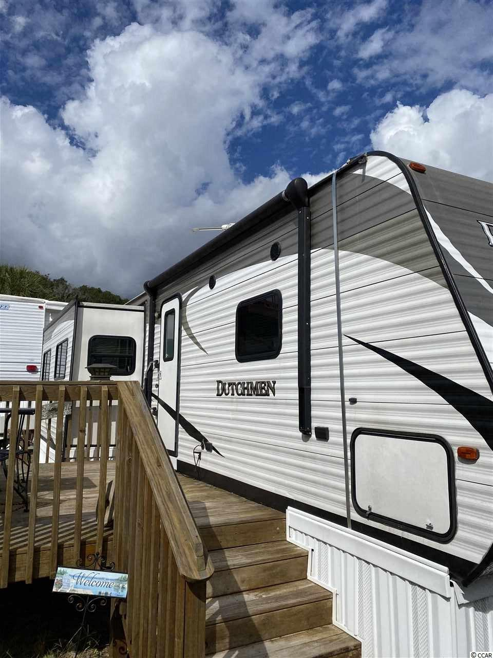 Beautiful semi permanent camper right on the beach !!! This 5 year old home is located in Apache Oceanfront Campground, with great amenities like On site restaurant with entertainment on the Fishing pier.  Bait shop.  Play ground.  Large outdoor pool, splash pool & hot tub.  24 hour gate guard.  Furniture and Transfer fee included !! Has heat pump to blow central heat and air in addition to roof AC. Propane stove and oven.  Use of sewer and water is included with lot fees, as well as lawn service & trash removal.  Queen size sleeper sofa in living room, right next to the electric fireplace.  Queen size bed, 8 foot bedroom closet and dresser.  Sleeps 4 comfortably.     Close to all the hotspots like Ocean Annie's Beach Bar, Flip Flops, Bimini's Seafood restaurant and the New Soho sushi and steaks on the water way.  Arcade, Laundry Facilities, Golf Cart Rentals, Beach Shuttle Service, close to golf, groceries, and restaurants.  Steps away from beach !  Come buy your affordable new home by the Atlantic Ocean !!!