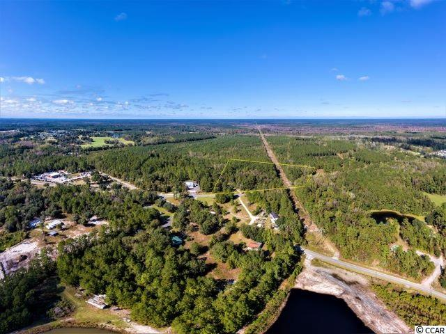 8 (+/-) Acres zoned CFA, with 800 sq ft of road frontage, in highly sought after area. Public utilities available. Perfect location for a strip mall.  With the 1,000s of homes coming, here is the perfect property for your business.