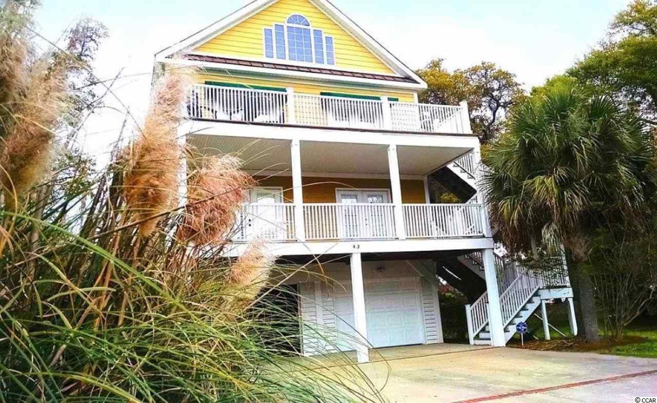 Fantastic 4 bedroom 3 bath home, with amazing views of the creek and marsh in Pawleys Island. Open spacious living area that leads through double doors out to one of the fabulous deck areas. Beautiful kitchen with a work island that opens to the dining area perfect for entertaining friends and family. Access the other deck through the master, the perfect place to start your day with your morning coffee or unwind at the end of the day watching the sunset over the creek. Plenty of storage with a 2 car garage under the home. No HOA and beautiful views make this home the perfect place to get away from your day. A great primary, vacation, or investment home. Close to all the area has to offer, shopping, dining, and more!