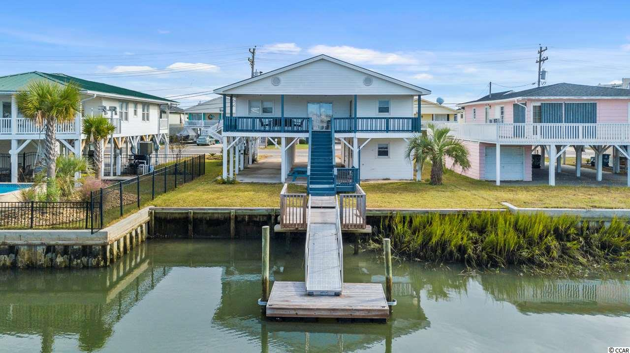 LOCATION - LOCATION - LOCATION!  Deep water channel with access to waterway during high tide.  Huge deck off living area overlooking private dock. HVAC replaced in 2018, New floating boat dock installed in 2018.  New roof  installed Jan. 2021!  Corps of Engineering dredging assessment had has been paid in full and is not financed into the property tax bill. Owners selling as it sits. Located with close access to the Cherry Grove boat landing.  Public beach access at the Ocean end of this street.