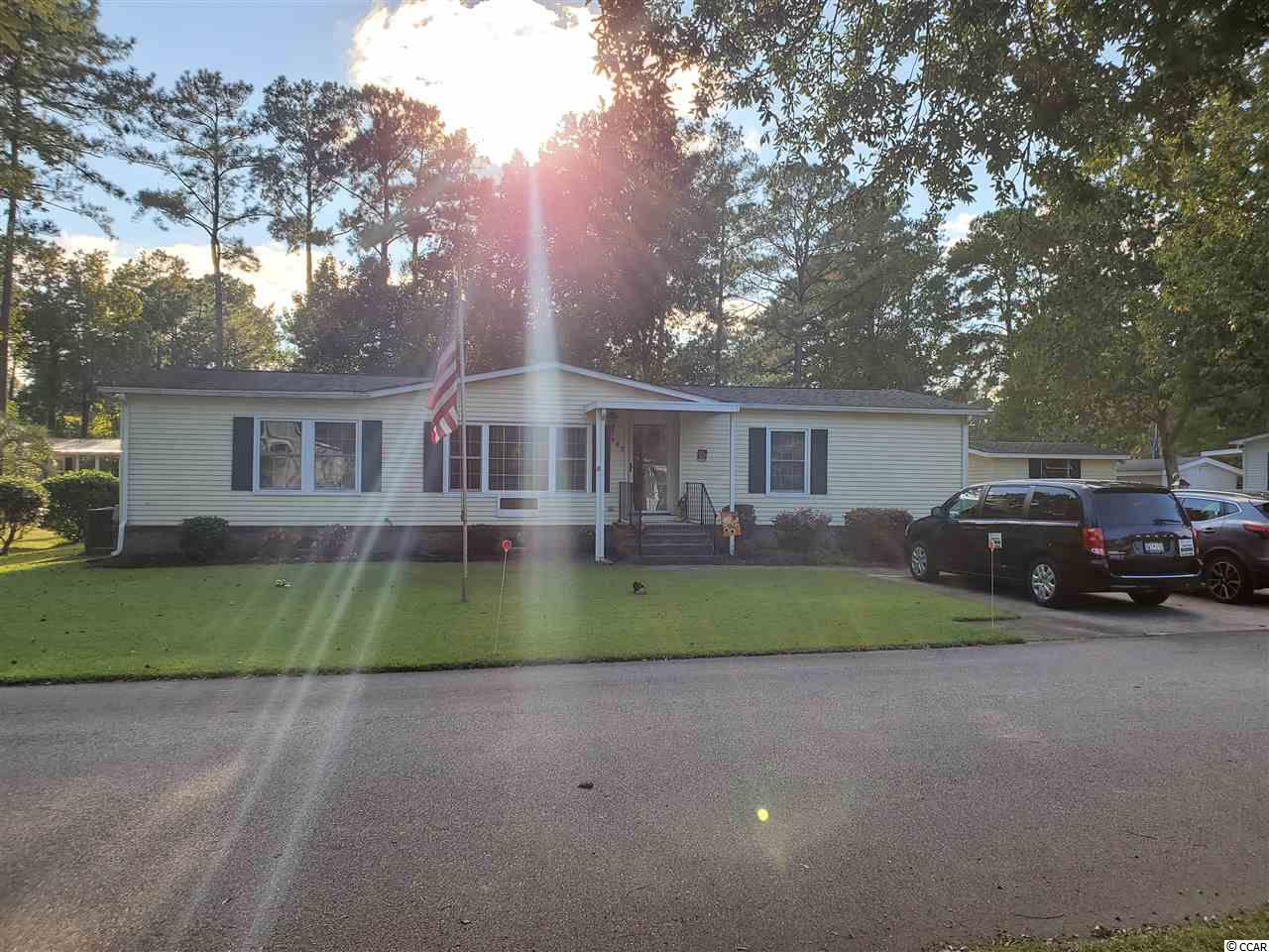 1 MILES TO GARDEN CITY BEACH . 55+ AGE COMMUNITY  , 2 POOLS  , CLUB HOUSE . 2 MILES TO MURRELLS INLET MARSH WALK. GREAT LAKE FRONT HOME  !  3 BEDROOMS ALL WITH WALK - IN CLOSETS . 2 FULL BATHROOMS . LIVING ROOM ( 13 X 18 )  , DINNING ROOM ( 13 X 9 ) , KITCHEN ( 18 X 12 ) , WITH CATHEDRAL CEILINGS .  FAMILY ROOM / CAROLINA ROOM HEATED / COOLED ( 25 X 12 ) . THE NEIGHBORHOOD HAS TWO ENTRANCES , GARDEN CITY CONNECTOR AND BUSINESS 17 HWY. Come and see this lovely, recently renovated home in the Ocean Pines 55+ community (formerly known as Jensens). This move in ready 3 bedroom home with large sun porch COOLED & HEATED . located just about a mile to the beach. New flooring throughout,  home a must have. Master Bath has a walk in shower LOW STEP  .  location ensures you easy access to all of the amenities.  Murrells Inlet has to offer including fine dining, the marsh walk and Shopping. Community has two pools for you to use as well as a community club house that offers lots of activities for the residents to participate in. Shed in the SIDE yard  Monthly fee includes the pool, club house and trash pick up. Pets allowed. What are you waiting for???  OPEN FLOOR PLAN . !!!   golf cart distance to the BEACH. 1 MILE AS THE CROW FLIES  !!!! , flag pole IN FRONT YARD . This is a golf cart friendly community, pets allowed. Rules apply.