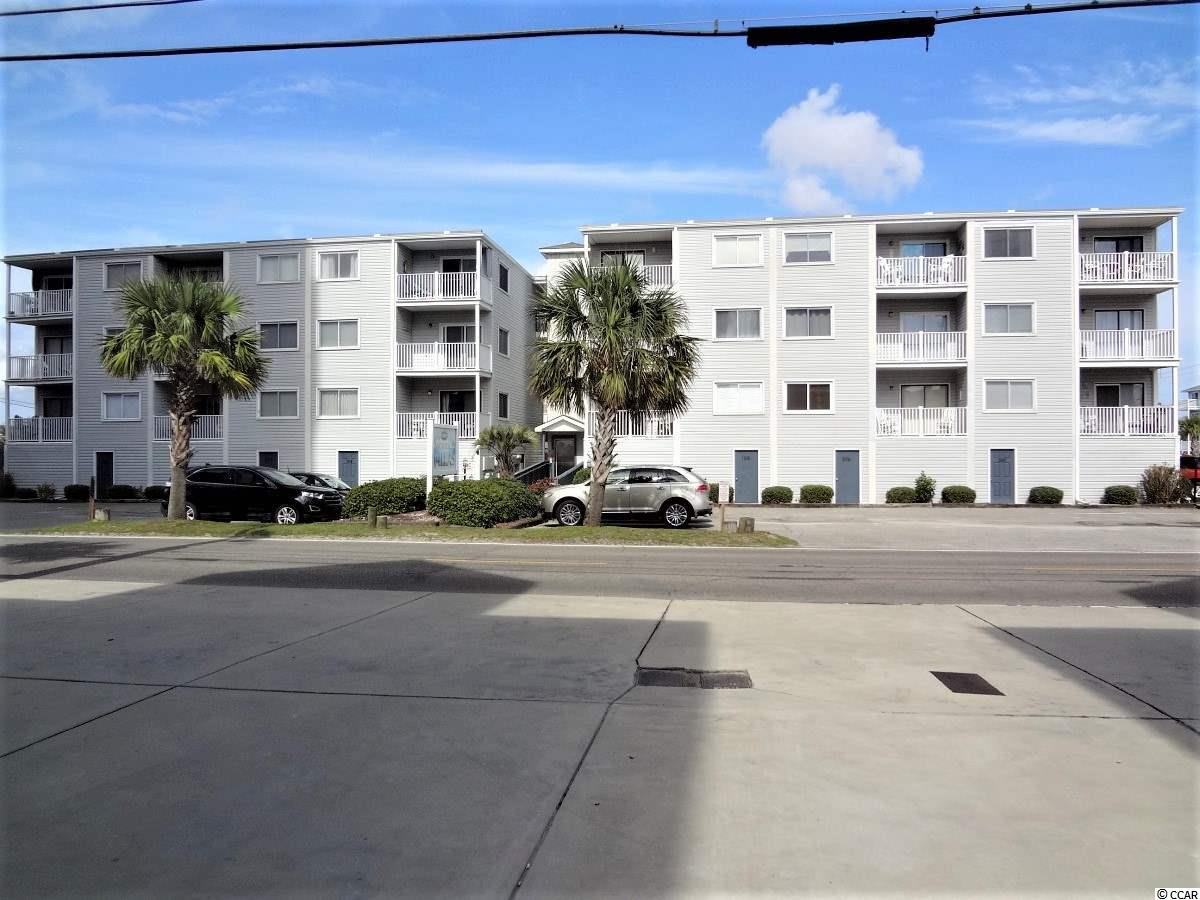Looking for an affordable 2nd home or rental property? Take a look at this 2 bedroom/2 bath ocean view condo.  Enjoy the ocean breezes and sneak a peak at the ocean as you relax on the balcony.  The condo is an end unit so there is even an additional window to brighten the great room.  The kitchen has a convenient breakfast bar and is open to the great room.  Sold fully furnished including TV's and all the appliances.  Owners replaced the HVAC in 2017 and water heater in 2019.  No carrying bags up steps as the building has an elevator.  Whether lounging or swimming owners can enjoy the private pool.  There are picnic tables and grills for owners enjoyment as well.  Located 2nd row a public beach access is just across the street.  A huge private storage unit on the ground level is included for storing all your beach toys and more.  All this and located close to all the activities the beach has to offer.
