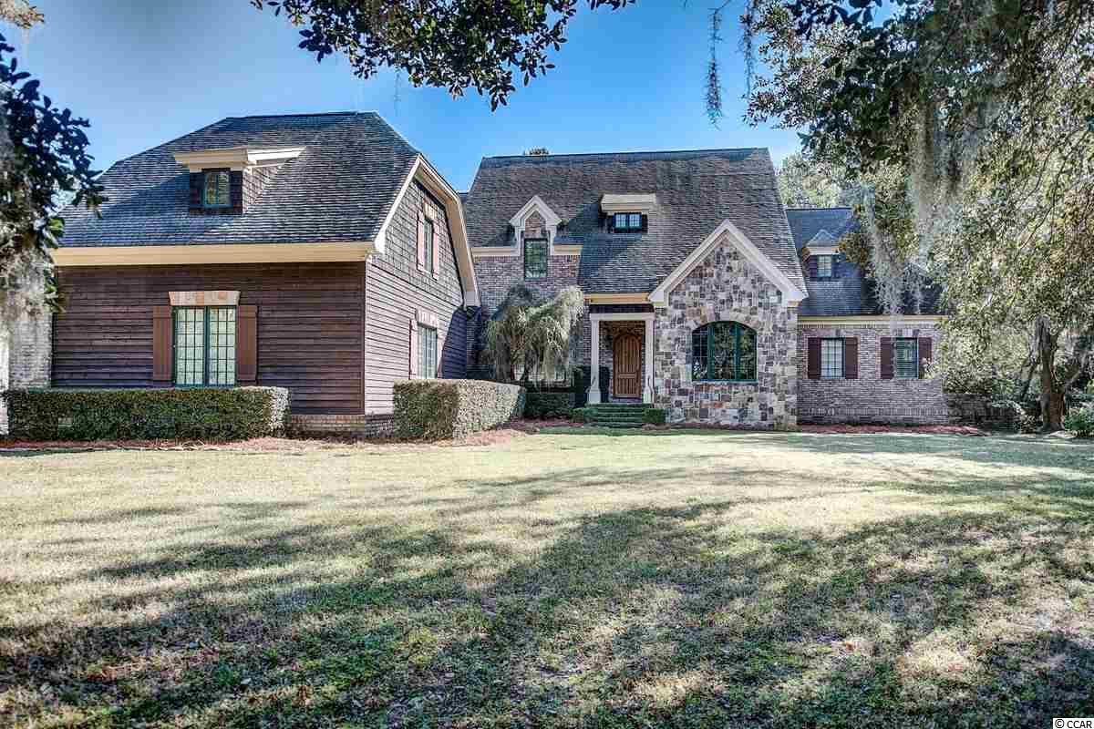 Set gracefully amidst moss draped live oak trees on an acre homesite in the desirable Waverly Creek community, this stunning residence has been masterfully designed to blend classic and natural architectural elements, to create a one-of-a-kind estate. As you enter the home, through the grand foyer entrance, you will be pleased to find the exceptional finishes on a grand scale. You will walk through a wrought iron gateway to the Study that has an adjoining full bath with stunning finishes. On the opposite side of the foyer, you will find a beautiful Formal Dining Room perfect for large gatherings.  The Formal Living Room, with its coffered ceilings, Australian cypress floors, and French doors that open onto a covered porch, overlooks the lusciously landscaped pool area with a wood burning fireplace. A chef's dream, the well appointed kitchen features granite countertops, cherry-topped center island with warming drawer, high quality custom cabinets and drawers, double gas range, stainless steel appliances and a Dining Area with a triple window and much more. Adjacent to the kitchen the large Keeping Room, with its travertine floors, built-in cabinetry and stone fireplace, provides a place where guests can congregate to keep warm with much space and comfort. The grand owner's suite offers a lovely sitting area, tray ceiling, a huge oversized walk-in closet, and a fabulous bathroom with double vanities, jetted tub, large tiled shower and travertine floors. There's another Master suite on the 2nd floor and three more spacious bedrooms with adjoining bathrooms.The Bonus/ Playroom is wired with Surround Sound System.  Just plug, play, relax and have fun! It also has a Wet Bar and Mini-fridge! You will be pleased with the amazing amount of storage including walk-in attic space, many closets and oversized double garage. There are Video cameras (inside and out) with TV and  phone Ap view, continuous recording(HonView phone-ap). Every room is wired with speakers in the ceiling for stereo.  Each room has its  own volume control.  Rock-Acoustic (this is the name of the speakers in the pine needles) speakers outside at the pool area.  Underneath, in the crawlspace, is a Vapor Barrier, throughout the entire crawlspace (very expensive), which is great to protect the home from moisture, protecting the hardwoods. This marvelous property displays a myriad of features and fine appointments that are too numerous to mention. For those seeking an active lifestyle, launch your boat on Waverly Creek for access to the Intra Coastal Waterway/Waccamaw River, golf at the many world class golf courses and ride your bicycle along miles and miles of bike trails or take long walks on Pawleys Island or Litchfield Beaches. Square footage to be verified by the buyer.