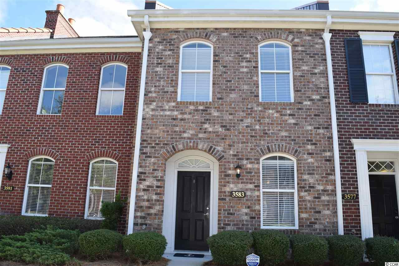 Wonderful central Myrtle Beach location close to everything!! This super clean, 2BD/2.5BA townhome has an open floorplan, private garage and a fenced courtyard! The kitchen has upgraded cabinets, granite countertops, island and dining room with accent moldings. There is a nice pantry and a laundry closet spacious enough for full size front loaders. The great room has large windows overlooking the courtyard. Interior features include 9' ceilings, window treatments and recently installed laminate flooring throughout the living areas up and down. There are two bedrooms with private baths on the 2nd level--one with a double sink & tub/shower, walk-in closet and built-in desk with shelving and the other with a single sink, walk-in shower and walk-in closet.  The community is intimate and walking distance to dining, shopping and schools.  It's just minutes to the beach directly on 38th Avenue North and to many of the areas finest attractions. Ideal to golf cart to the beach and out for an afternoon of fun. This home is move in ready for you!