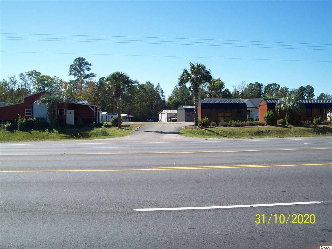 EXCELLENT HIGHWAY 501 FRONTAGE LOT EAST OF CONWAY, HIGHWAY COMMERCIAL ZONED LOT, HAS 100 FT. ON 501, NEW SURVEY PLAT ON FILE, LOT IS HIGH AND DRY, HAS CONWAY WATER AND GRAND STRAND SEWER, BENNETT BUILDINGS IS A MONTH TO MONTH TENANT, GREAT PRICE!!!!!