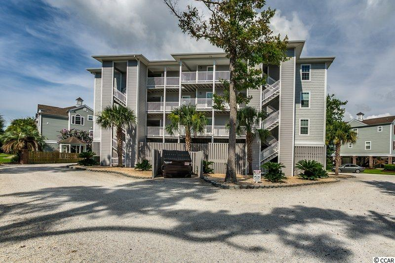 Welcome to your new home or your home away from home!  This fabulous condo is a quick stroll or golf cart ride away from the beautiful beach and the Surfside Pier.  It's all about location and this condo is close to any and everything you could want or need!  Restaurants, shopping, the beach, and even the local market are all walking distance from this pristine condo. The master bedroom is huge and features a sliding barn door into the ensuite bathroom.  There is a second bedroom and full bath for the enjoyment of your guests.  The kitchen features stainless steel appliances, and granite countertops with a generously sized breakfast bar and gorgeous custom painted cabinets.  The living and dining area welcome lots of natural light from two sliding glass doors leading out to the screen porch.  This 21.9 x 5.8 space is the perfect spot to enjoy the breeze while you sip a cocktail or a cup of coffee.  Floor to ceiling shades are perfectly cool during the summer sunny months. From May to October walk across the street on Tuesday's to Memorial Park home of the Surfside Beach Farmers Market.  There is a shared owner's closet to store all of your beach and pool toys.  Park your golf cart under the building and get ready to love living the Surfside Beach lifestyle.  Disclaimer: All square footage is approximate and is not guaranteed. Buyer is responsible for verification.