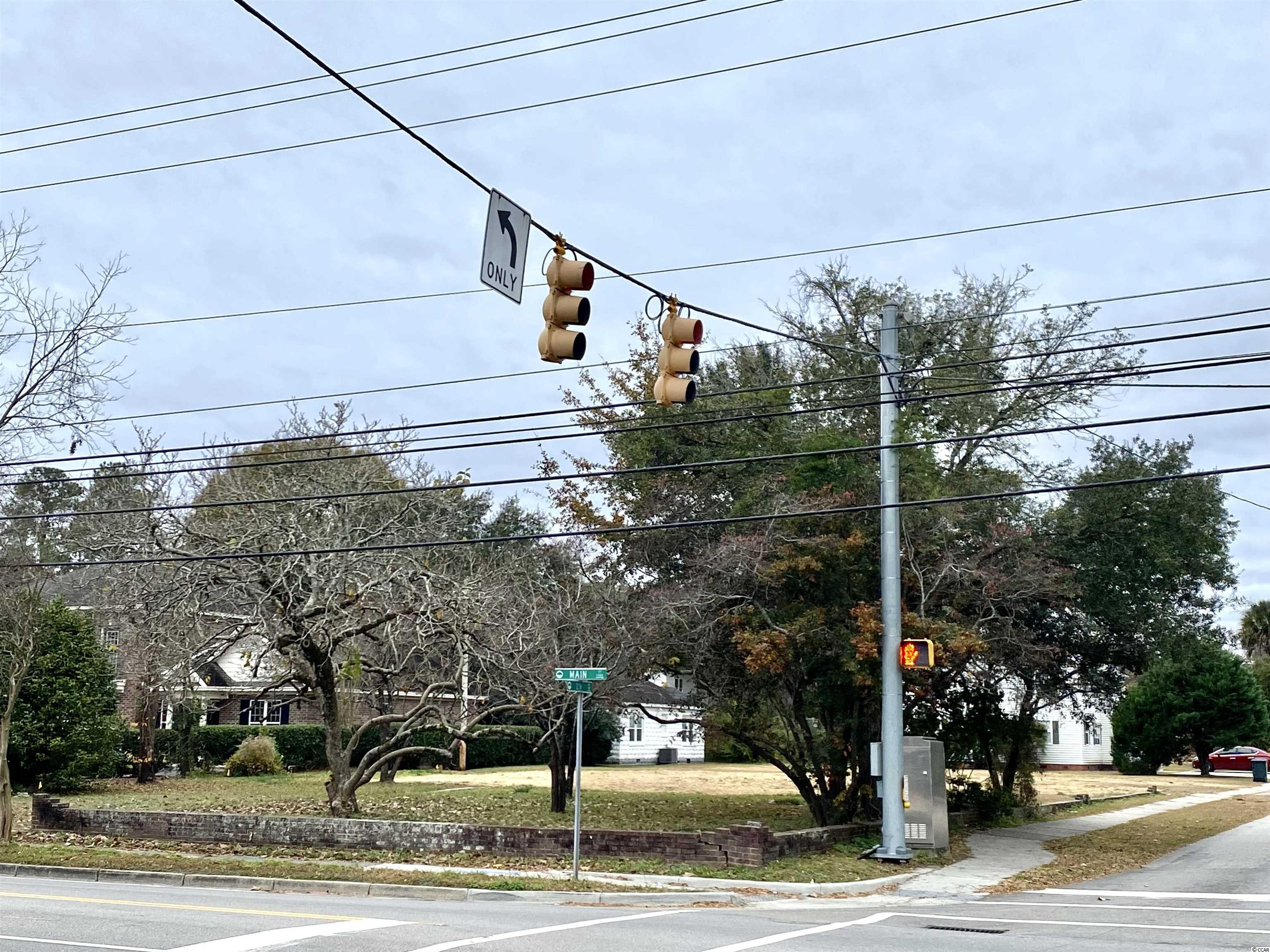 Rare opportunity to own a large corner lot on Main Street. 87x232 lot, .46 acre. Home has good bones but would need total rehab. Zone Professional and R2. Call today for information on possible uses.