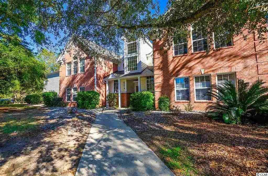 Spacious 4 bedroom 2 bath End Unit in the Murrells Inlet community of Riverwood. Bask in the wooded views from every window while enjoying the privacy this location offers. Large sunroom with a deep closet provides extra space. Used only as a secondary home and never rented this property is in excellent move-in condition. New HVAC in 2015, New roof in 2019, Sold Fully Furnished and complete with washer and dryer. Oversized primary bedroom has 2 walk-in closets and large bathroom-suite. 3 guest rooms make this condo a great place to entertain, have the whole family down or use as office and hobby rooms.   Riverwood is located right next to the Waccamaw hospital system. Community pool and tennis courts on site. Located in Murrells Inlet Riverwood is close to the Marsh Walk and a plethora of restaurants, shopping and activities.