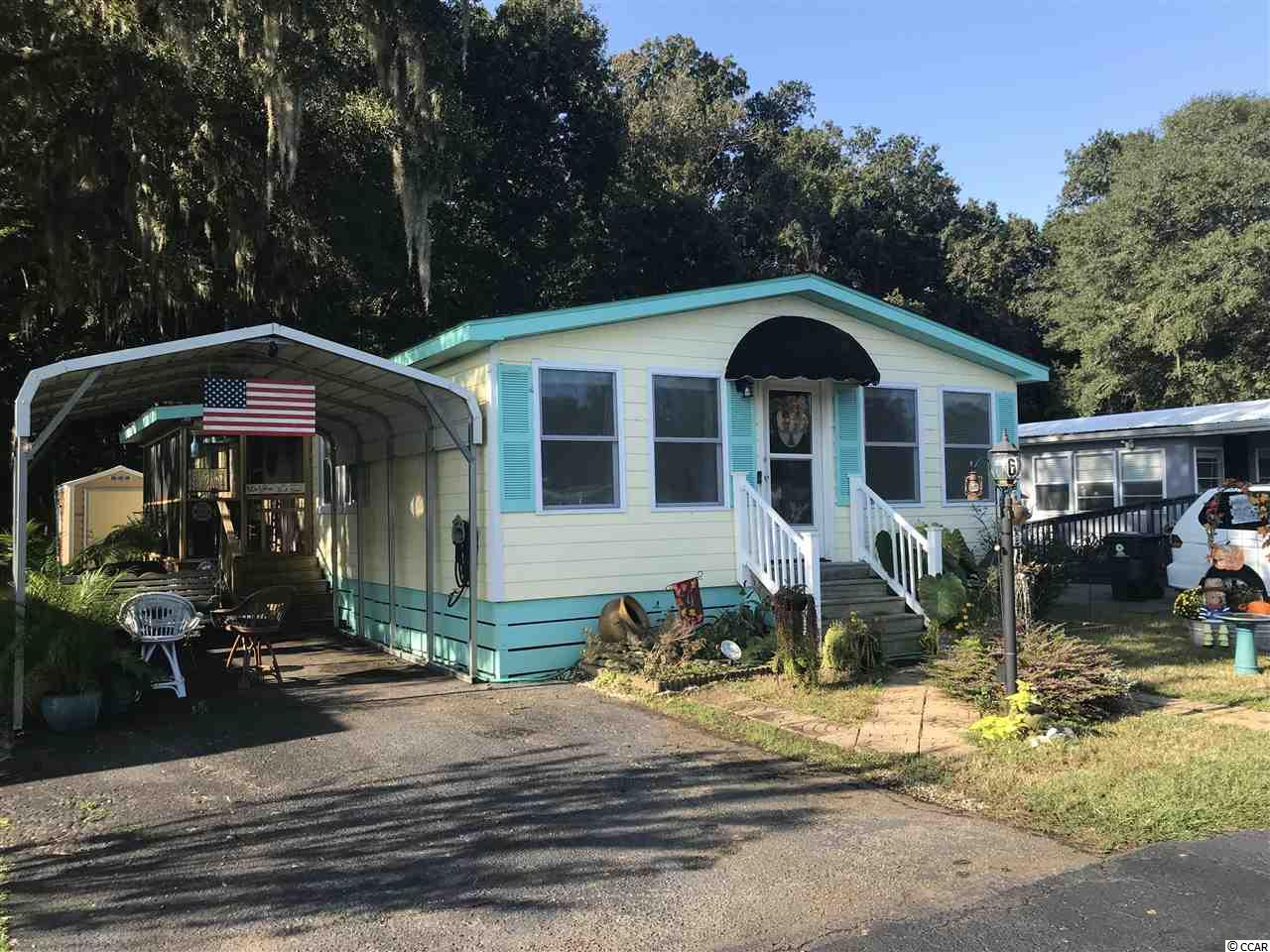 LAKEFRONT HOME in 55 & Older community.  Use the path to walk or ride to Huntington Beach that is only 1 mile away!  Lots of improvements in this well kept home including:  new roof, ship lap paneling and hot water tank; Also enjoy the addition of the 4 Season/Carolina room (10x23).  This 3 BR 2 BA home boasts a large kitchen with a breakfast nook; large living room; separate dining room; screened in porch; and storage shed.  The view overlooks the pond and home is located on a dead end road that offers additional parking. Use the Clubhouse, pool, and participate in activities.  Community is close to Murrells Inlet's Waterfront restaurants as well as the hospital and doctor offices. FREE SECURE AREA FOR RV AND BOAT PARKING!!  COME SEE THIS ONE IN PERSON!